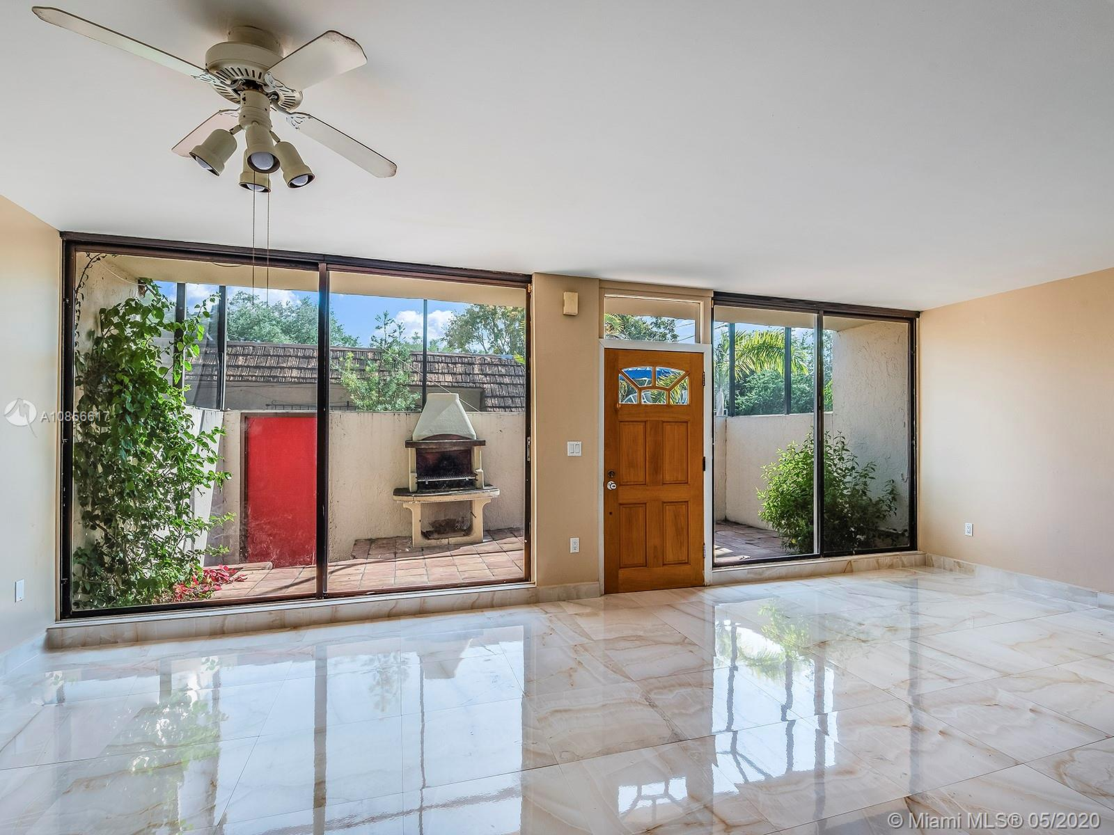 Remodeled 2 bed, 1.5 bath townhouse in the heart of Coconut Grove. This spacious unit features new bathrooms and an updated kitchen with stainless steel appliances. The large sliding glass doors fill the apartment with natural light, creating a beautiful shared space between the indoor living room and the large outdoor private deck – perfect for entertaining. Walk to all of Coconut Grove's restaurants, nightlife, shops, and parks. Next to US1, steps from Milam's Supermarket, Home Depot, and the Metrorail.