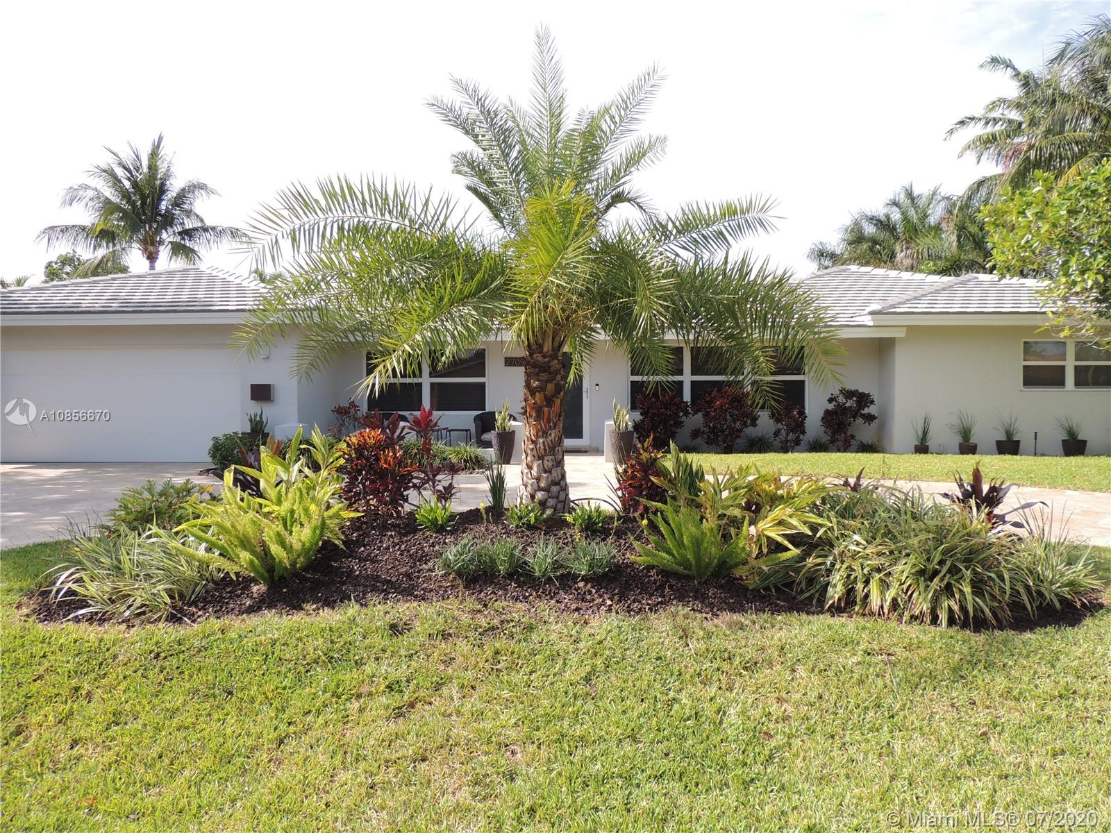 Remodeled home in much desired Coral Ridge. Open floor plan with 3 large bedrooms, bonus room that can be converted to a 4th room, living room and family room. Perfect house for entertaining. Kitchen overlooks the tropical pool and has Brazilian blue granite countertops with KitchenAid appliances.  Large walk in pantry with indoor Front loader washer /dryer. Beautiful travertine circular driveway and pool deck. Oversized pool with Catalina color ,blue iridescent tile, estimated 8 ft deep ,infiniti waterfall and large sitting bench.  Custom doubledeck fort -7 ft.  slide on artificial grass. Tropical trees mango, avocado, star and jack fruit. Fully fenced backyard with updated landscaping. All impact windows and doors, roof 2018, new water heater, pool pump, and epoxy garage flooring.