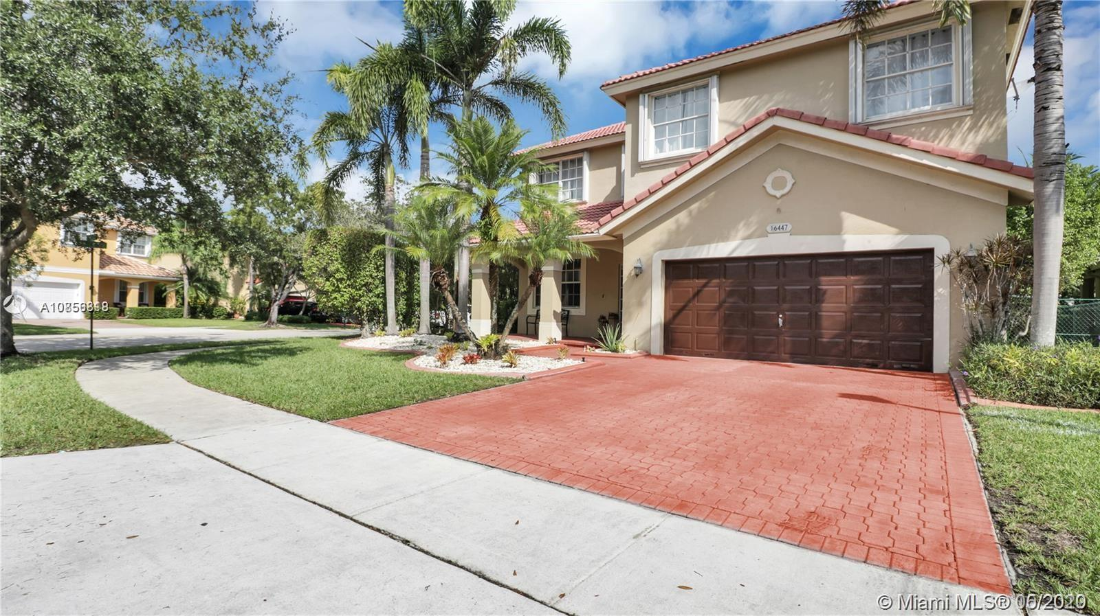 BOGO Amazing 20K+ towards closing cost. 2 different Appraisals Came in @ 536,000 on this Stunning Updated 5/3 home with room for a POOL on a Corner LOT. Some of the home features are Diamond shape tiles downstairs, wood floors on the stairs & hallways, and fresh plush carpet in the rooms. New Stainless steel appliances, front load washer/dryer upstairs, spectacular natural lighting from all areas of the home, 2 car garage and room to park multiple cars on the concrete stamped driveway. Enjoy eating on the master bedroom balcony or bathing in the outside hot tub the home comes with. The home is gated and has a great backyard to entertain all sizes of events. 2 AC units, accordion shutters and hurricane panels. Ready to move in.  Special terms applied. Original safe and sound roof.