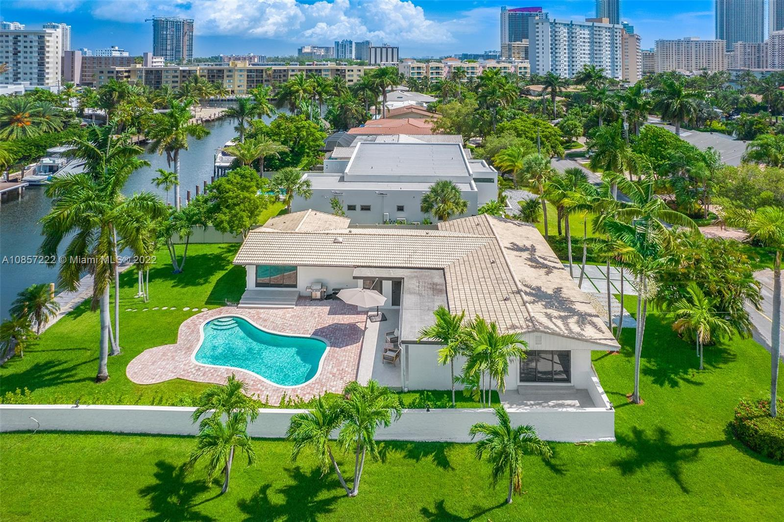 ONE-STORY CORNER WATERFRONT HOME ON 85' X 135' LOT, BUILD YOUR NEW WATERFRONT ESTATE. OCEAN ACCESS AND NO FIXED BRIDGES. CENTRALLY LOCATED BETWEEN BOTH MIAMI AND FORT LAUDERDALE./