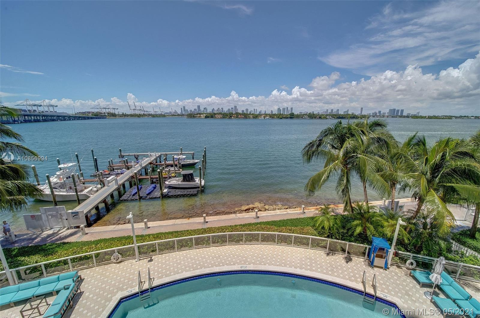 Enjoy stunning views of Biscayne Bay and Downtown Miami from this large 1 bedroom condo. This unit features an open layout with kitchen bar open to living/dining room combo.  Tons of closet space with a walk-in and additional closet in the bedroom plus another closet in the hall.  Bathroom can be accessed from hall or master bedroom.  Washer and dryer in the unit.  One assigned spot in the garage on the first level.  The Floridian is a luxurious full amenity building with 2 bay front pools, a gym and spa, concierge, a gourmet market, salon, security and complimentary valet for guests.