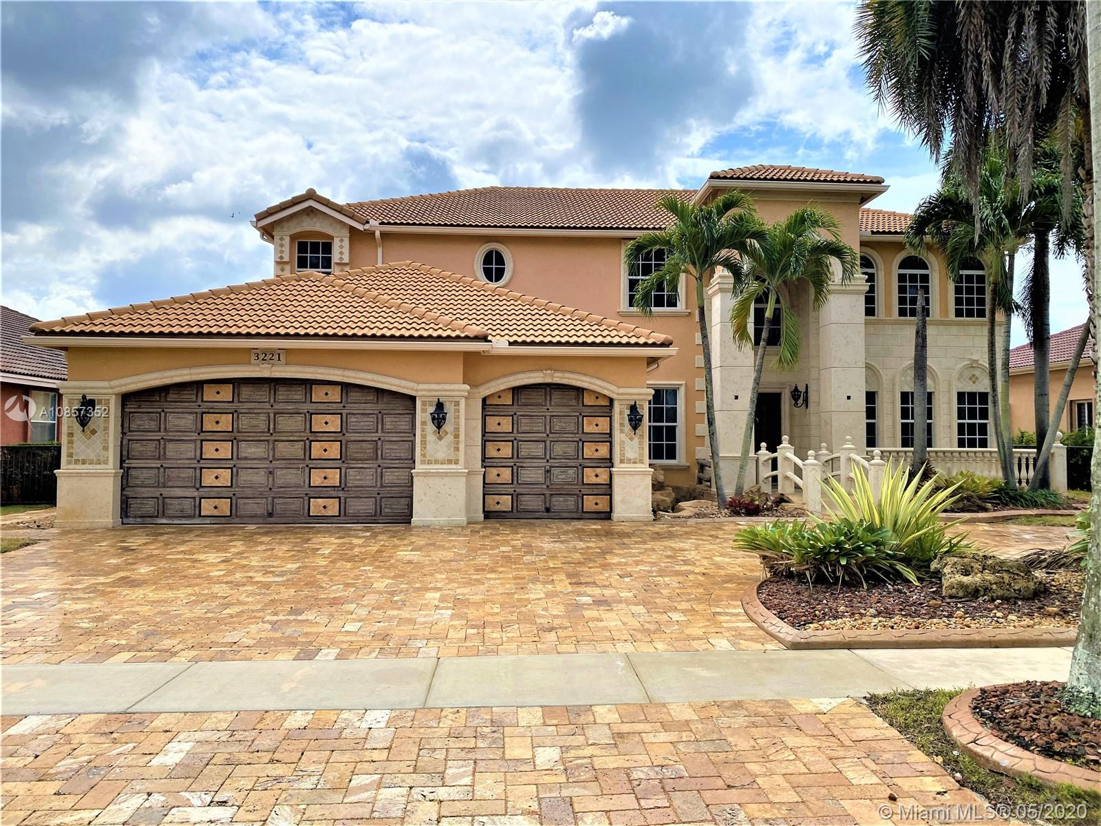 Don't miss this palace in sought after Sunset Lakes Community. Enjoy such amenities as gated entry, beautifully manicured green areas, access to clubhouse, pool and recreation rooms and proximity to major roadways and shopping. Magnificent rock grotto with slide and waterfall encloses a private hot tub.  Pool has been recently plastered and looks amazing! Travertine pavers throughout exterior. The potential is endless and needs only your creative and design touches to finish this remodel. Selling As-IS. Buyer to assume all open permits.