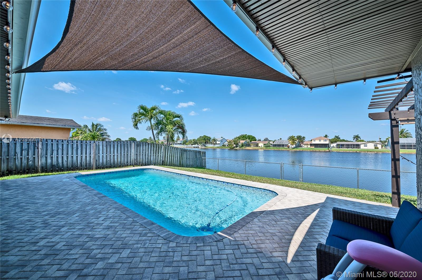 """No HOA! Everything you could possibly want in this lakefront w/pool Entertainers Delight! BRAND NEW ROOF in 2018! Fully fenced, refinished pool & paver patio with lighted Pergola for making the most of the South Florida Lifestyle. Welcome to your Dream Kitchen, featuring quartz counters*tile backsplash*under counter lighting*42"""" cabinets with soft close drawers*SS appliances & gas stove for cooking. The eat-in kitchen & family room open to the pool patio. The appealing split bedroom plan with updated baths is perfect for everyone. One of the most beautiful streets in Sunrise, lined in Royal Palm trees, are sure to delight upon arrival to your home. Outstanding location, within minutes to Sawgrass Mills Mall, easy I75 access to points, north, south and east. Not to be missed!!"""