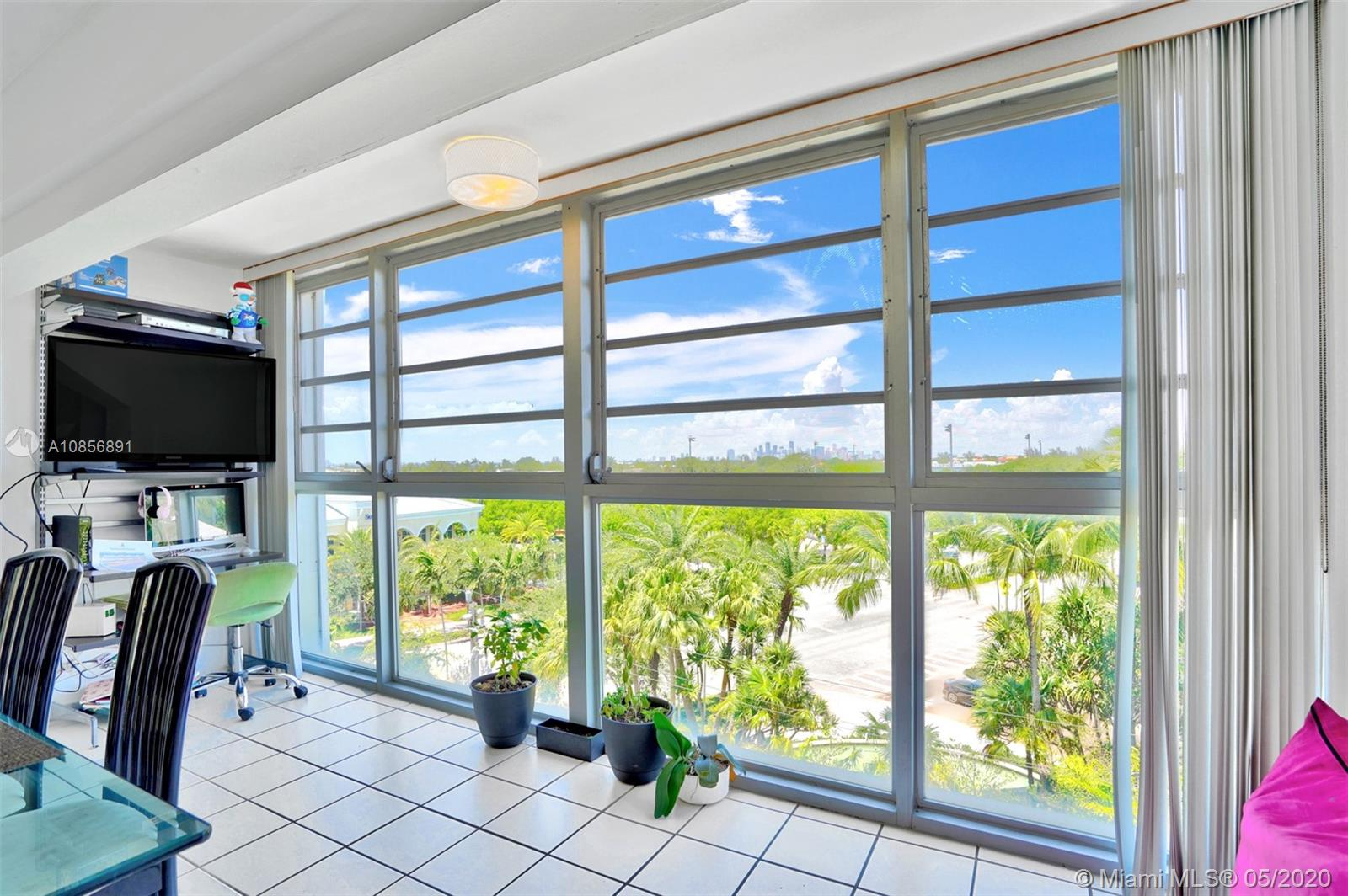 Floor to ceiling windows with views of picturesque island Village Green greet you upon entering this lovely 2 bedroom 2 bath condo just steps from the white sandy beach of Key Biscayne. Residents benefit from closely located elementary school, shops, restaurants, community center, gym, playground and park. The Miami skyline can be seen from the living room at night and the sunrise can be seen from bedroom windows. One assigned parking.. Lobby recently updated. This property is move in ready and is a great opportunity to own in Miami's most sought after tropical oasis.