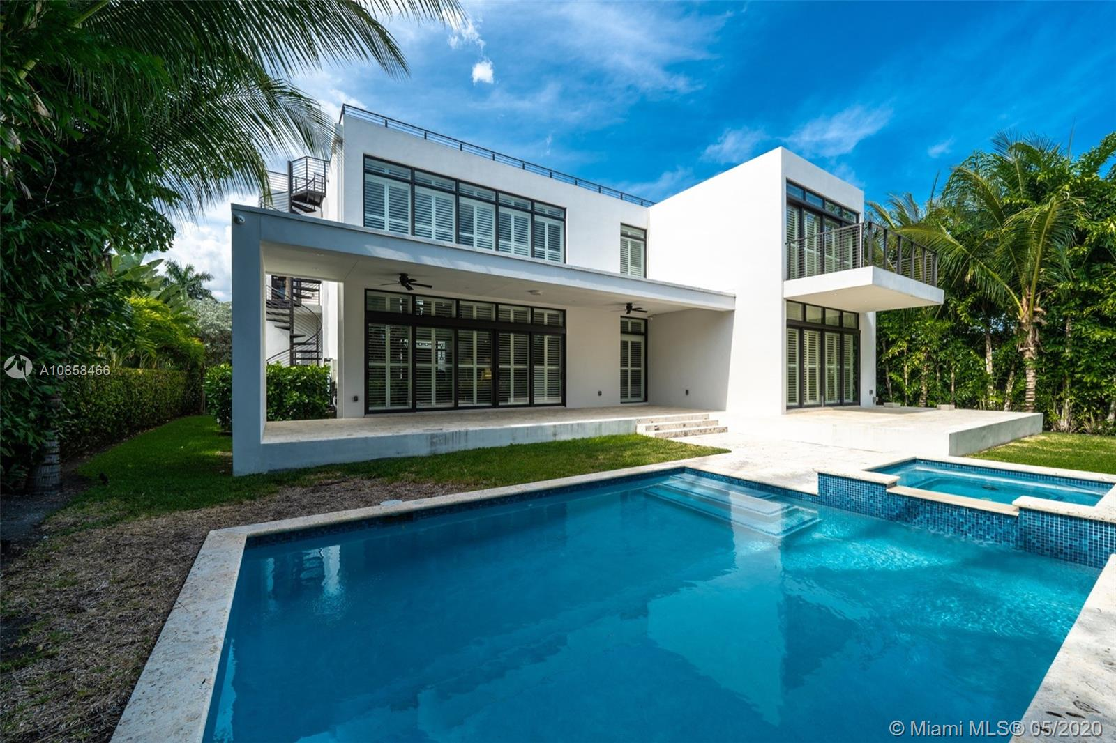 This spectacular gem is nestled in the beautiful Bay Harbor Islands community.  Contemporary designed, 2-story home featuring 6 bedrooms and 6.5 Bath + a Study.  Almost 5,000 sq ft under air.  Gorgeous floor to ceiling impact windows allow for plenty of natural lighting.  Enjoy the outdoors in a sprawling rooftop terrace with partial water views.  Virtually staged images were uploaded to show the potential.  Large modern kitchen with a cook top and built-in Sub Zero.  The enormous living room with double volume ceilings is bright, welcoming and overlooks the  pool/spa combo. Home features an elevator and 2 Car Garage with circular driveway.