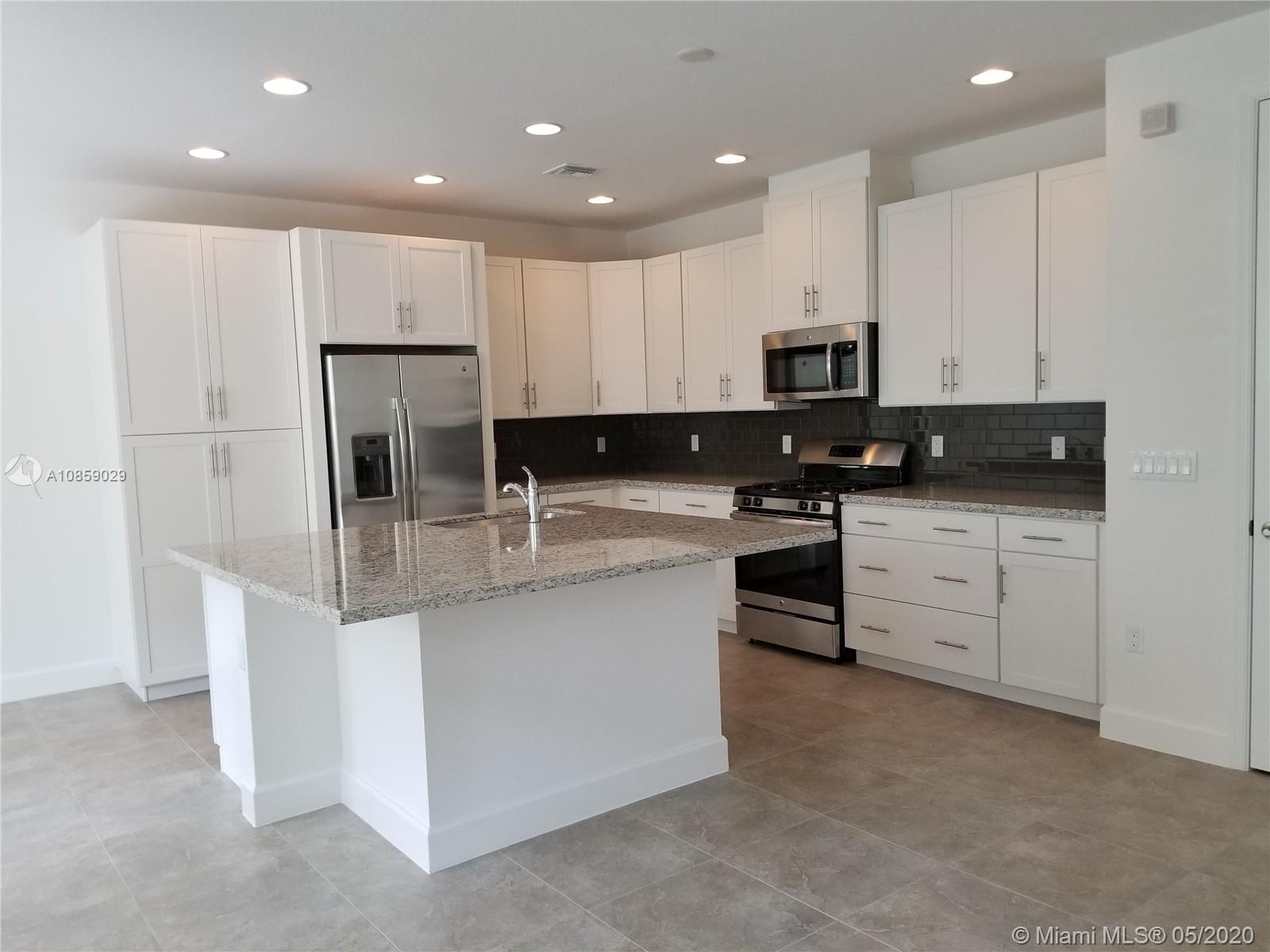 Great opportunity to own new construction, never lived in, upgraded townhouse in the resort-style community of Artesia. Don't walk, run to this unit before it sells. Upgraded kitchen with granite countertops, stainless steel appliances, upgraded cabinets. all impact windows throughout. Spa-like master bathroom with a soaking tub and separate oversized shower. Recessed lights throughout. Community offers several pools, tennis courts, half indoor basketball court, BBQ area, pool tables, party rooms and many more places to enjoy the afternoons. Hurry and call for a private tour.