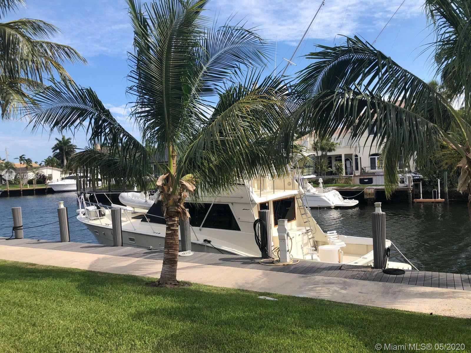 Location, Location, Location No fixed bridges and 100 feet of dock space close proximity to the Hillsboro and Boca Inlets! Live in the coveted Lighthouse Point Neighborhood on this quiet street with NO THROUGH TRAFFIC! South orientation. $ 30,000 cash back at closing towards your dream pool or kitchen. 3 bedroom, 2.5 bathrooms, 100 Foot of A+ Deep Water/dock, open views of the beautiful, wide, North Grand Canal from most rooms, only 600 yards to Lighthouse Point Yacht Club Marina with quick access to dual ocean inlets (Hillsboro & Boca Raton), Also, two perfect guest bedrooms or hobby/office use, impact windows/doors, new roof in 2014 and a security system equipped with exterior cameras. The dock is built of concrete and composite and can accommodate multiple boats. Large 10,000 sf lot.