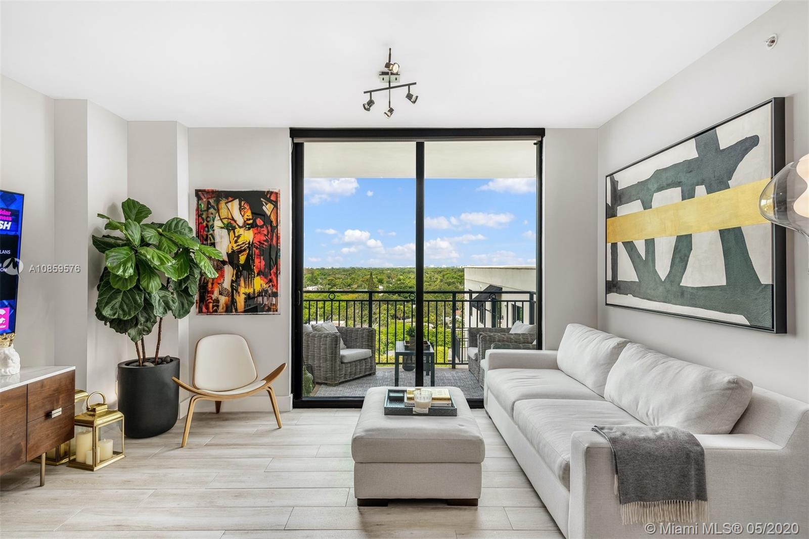"""Conveniently located on the Coral Gables corridor, Ponce de Leon Boulevard. Tastefully designed and fully renovated in 2019. Well thought-out, one-of-a-kind 2 bedrooms 2 bath featuring 2 parking spaces and 2 terraces (one over 500 sq ft) overlooking the famous Biltmore Hotel. Gorgeous kitchen with waterfall calacatta marble counter top and large pantry. Perfect for entertaining. Oversized master bedroom and bathroom include top of the line toilet and fixtures. This unit was designed for the perfect """"turn key ready"""" consumer.  Calming unobstructed West views of Miami. Sunsets will make you want to stay here and make it your home! Building amenities include gym, pool, 24/7 security & concierge, club room and community play area. Give us a call today!"""