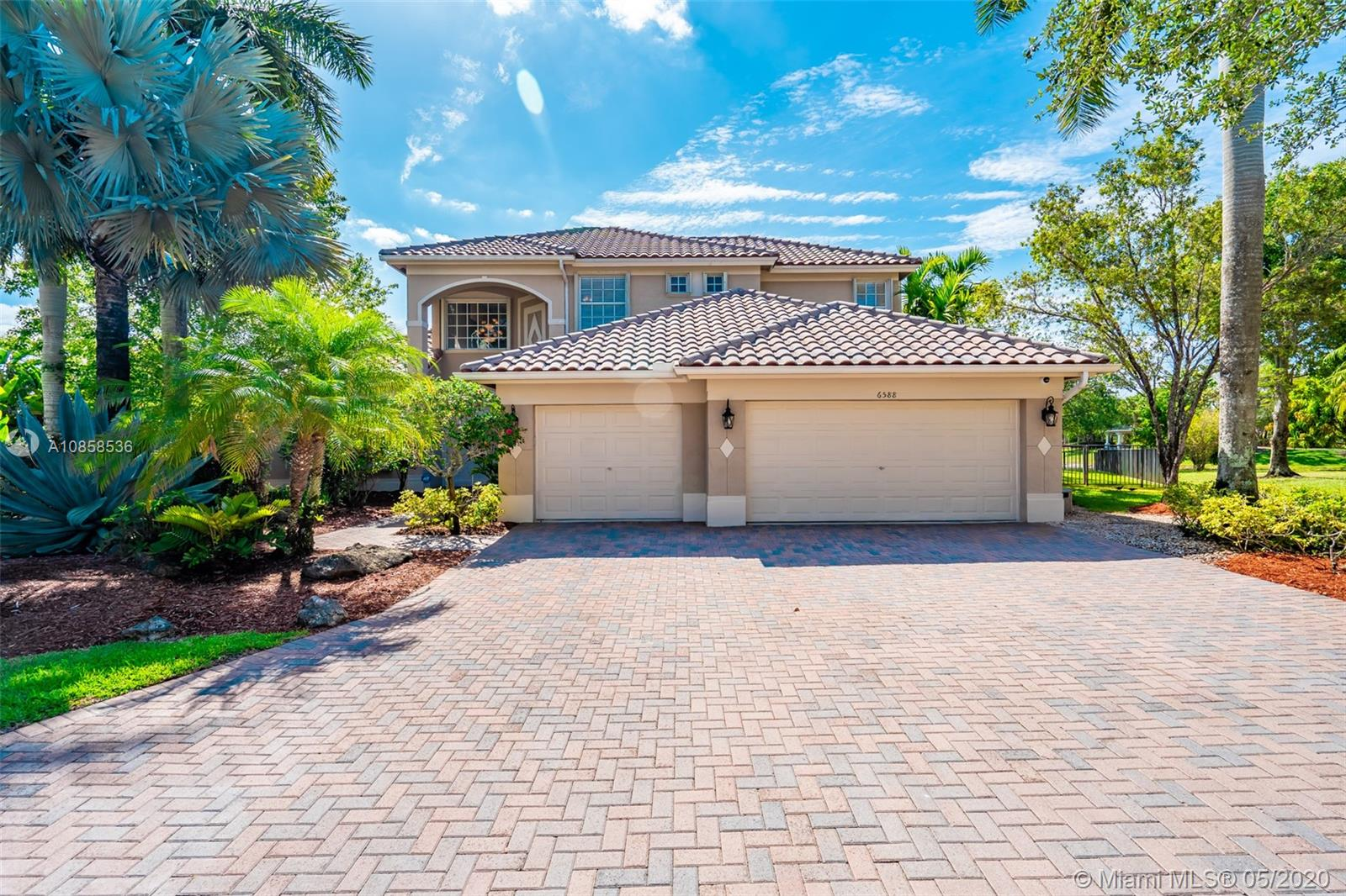 WOW!! Great opportunity to move right into this PRICED TO SELL spacious one of a kind CUSTOM Home featuring 5 bedrooms 4 baths 3 car garage located in Bayside Estates with a fabulous oversized culdesac lot. Fenced area, beautiful heated pool & spa on a large wide lake complete with generator hookup & accordion shutters or impact glass throughout. New Roof in 2006. Updated bright kitchen with quartz counters & eat-in area, updated bathrooms, carpet free first floor. Second floor makes great kids wing with 3 bedrooms 2 baths plus loft! Service contract included. Enjoy living in Parkland Isles with 2 access gates, clubhouse with onsite management, fitness, pool, & tennis. Square footage as per builders plans is 4819 under roof & 3733 under air!