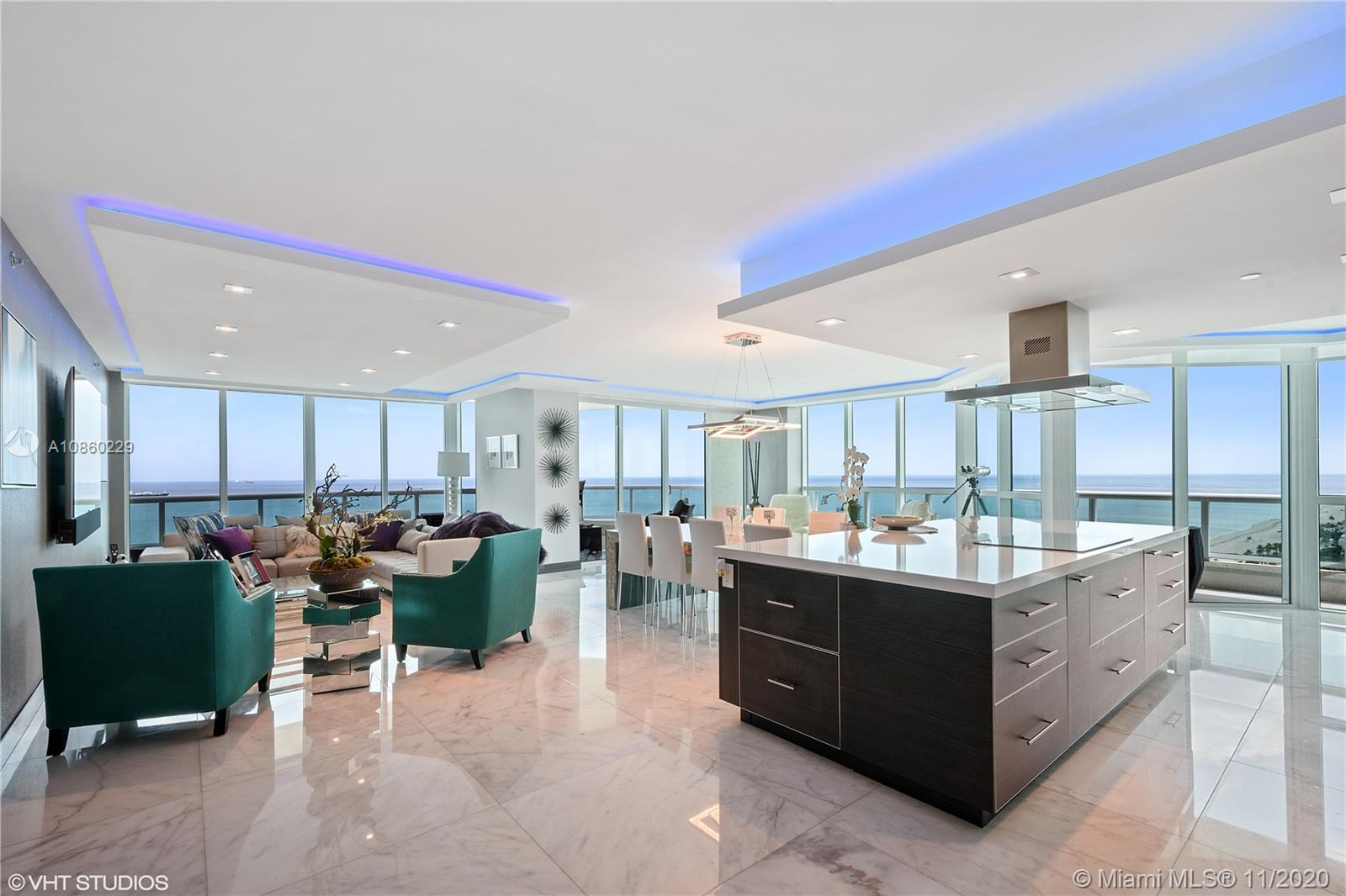 PRIME LOCATION ON A1A WITH PANORAMIC SE OCEAN VIEWS ON THE 24TH FLOOR! THIS BEAUTIFUL TURNKEY CONDO IS ONE OF THE VERY FEW HI-RISE BUILDINGS ON A1A!  THIS STUNNING CORNER CONDO BOASTS 3,000 SF WITH 180 DEGREE FLOOR TO CEILING VIEWS OF THE OCEAN, INTRACOASTAL, AND DOWNTOWN LAS OLAS! STEPS FROM THE BEACH, ENTERTAINMENT DISTRICT, SHOPS, MARINA & RESTAURANTS! CUSTOM CONDO FULLY REMODELED FROM THE GROUND UP WITH SPACIOUS OPEN KITCHEN WITH ATTACHED WATERFALL ONYX DINING TABLE FOR 8! MEDIA RM  WITH 125 INCH SCREEN, SURROUND SOUND SYSTEM, SMARTHOME, MARBLE FLOORS, ALL ROOMS WITH VIEWS, NO EXPENSE SPARED! 5 STAR BUILDING OFFERS 24 HR SECURITY, VALET, CONCIERGE, RESORT-STYLE POOL WITH CHAIR SERVICE, BBQ GRILLS, GYM WITH ONSITE CLASSES, PARTY ROOM, EXTRA STORAGE & PARKING AVAILABLE! ONE OF A KIND!