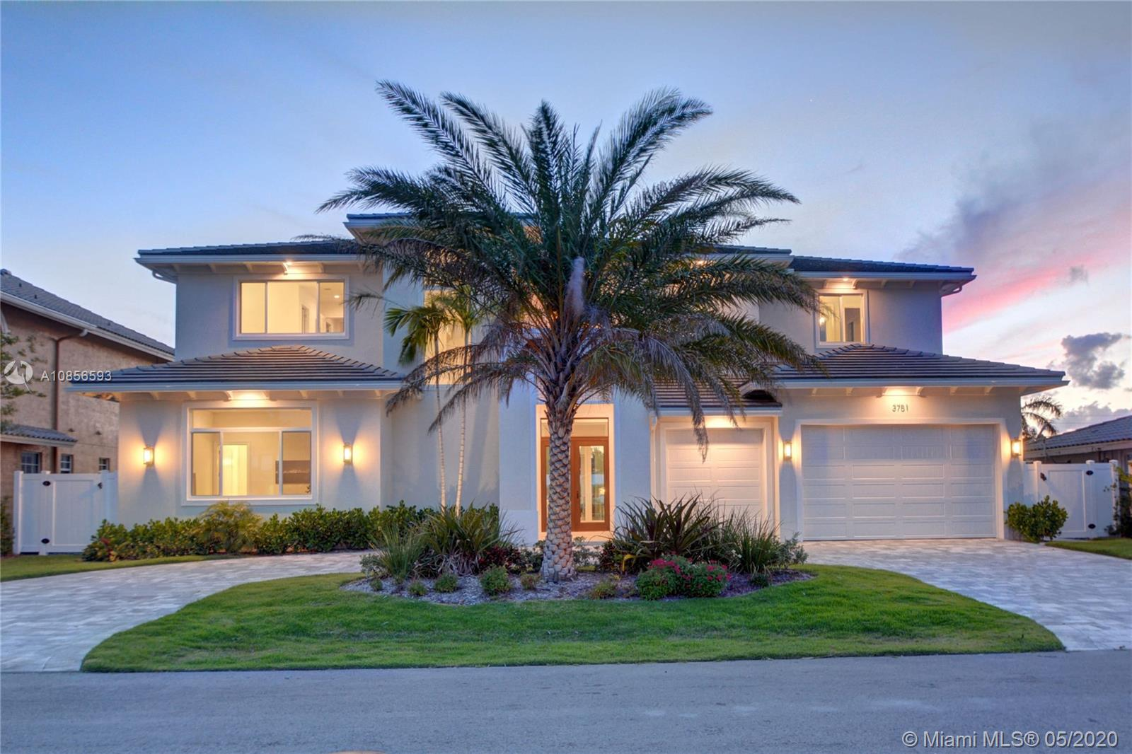 Beautiful coastal-inspired estate in highly desired Lighthouse Point. This 2017 built and meticulously designed 5 bedroom, 6 bathroom home impresses with a bright open floor plan and uncompromising quality and craftsmanship. Gorgeous open space kitchen with high-end appliances, custom cabinetry, pantry and more. Living room features breathtaking full-width floor-to-ceiling sliding glass doors leading to an expansive loggia with integrated summer kitchen and a resort-like pool with sun shelf entry. Luxurious oversized master suite with panoramic pool and water views. A boaters dream with new full-service yacht dock, minutes to Hillsboro Inlet. This is the perfect home for living and entertaining in style.