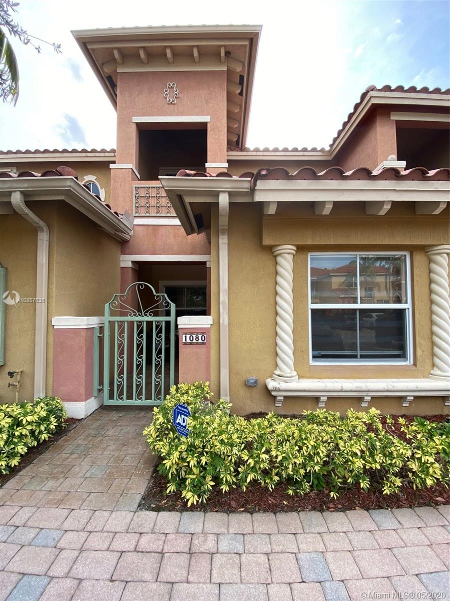 This immaculate townhome is set amongst manicured grounds within a private and secure community. The floor-plan incorporates 2 bedrooms and 2 bathrooms on the upper level, with a half bathroom on the lower level. The main level offers a modern kitchen with quality appliances, a concealed laundry, a Florida room and a spacious living/dining area completely surrounded by high impact windows and impact doors, just in time for hurricane season. The interior flows effortlessly from the open living space to the private open patio from which you can admire the water-views of the canal and beyond. With its warm sense of community, and only moments to the Shops at Pembroke Gardens, Pembroke Lakes, eateries, I-75 and other transport, this home provides all the elements for relaxation and comfort.