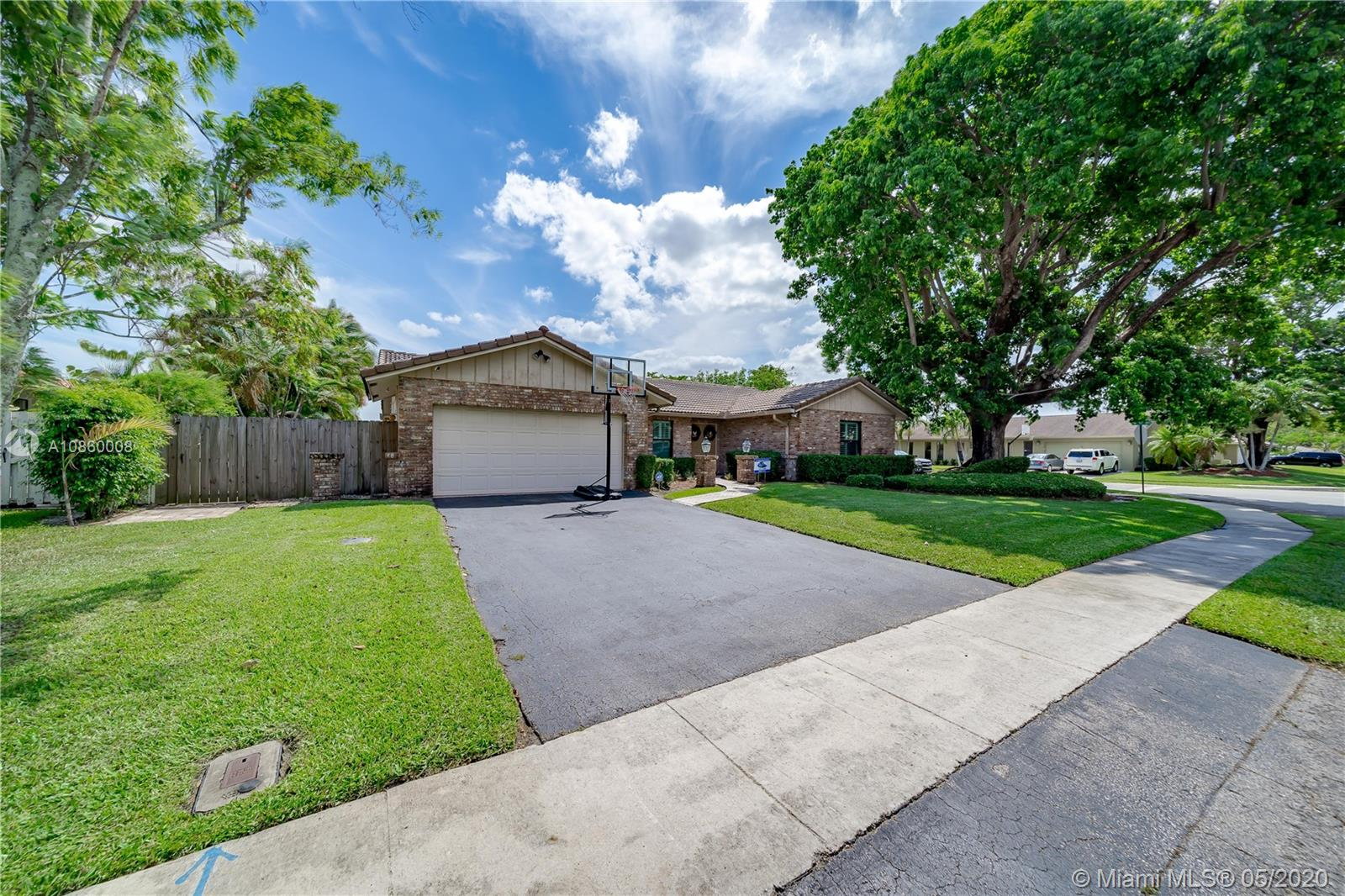 This is the updated home you've been waiting for! Enjoy your drive home on this beautiful tree lined street in one of Plantations most prestigious neighborhoods, Jacaranda Lakes. Stunning 4 bedroom 2 bathroom home on an oversized corner lot. Updated kitchen with granite and overlooking the pool, and family room. Bathrooms and floors have been tastefully updated. Hurricane impact and doors throughout so no worries here going into hurricane season! LOW HOA! Zoned for one of the best rated elementary schools in the county! Easy access to highways, shops and restaurants!