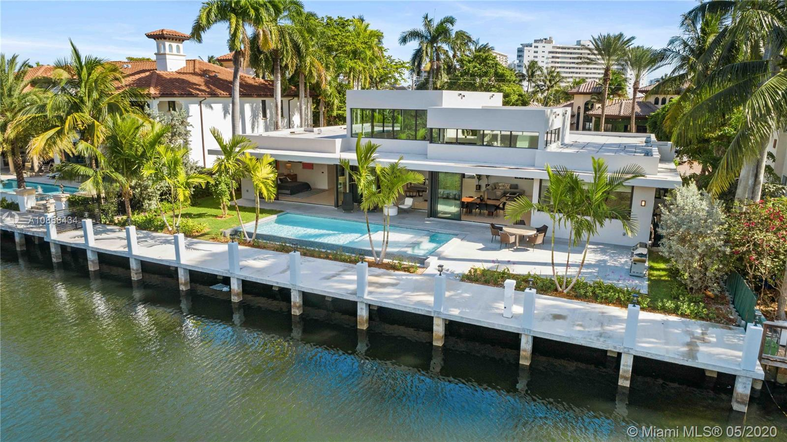 New construction, One Story Modern home, on 100Ft. of deep water. A Yachtsman's Paradise! State of the Art home with Lutron home automation, smart system wired for window treatments, lighting, speakers & voice control ready. Honeywell security system, SIW high impact energy efficient windows with protective film.Concrete dock, Chefs Kitchen incl gas stove, SubZero & wine storage, Steam &Electric oven. Heated infinity pool with spa, 2-car garage, 4 bedrooms, 4-1/2 baths.