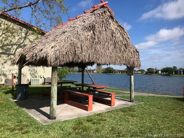 Beautiful 2 bed/2 bath unit with lake views and high ceilings.  Unit has been renovated!  Wood cabinets and granite countertops, new appliances, new A/C unit, new blinds and all tile floors.  Gated lake community with pool area and BBQ.  Good location.  Unit is rented until July 14th, 2021 for $1,350/month.