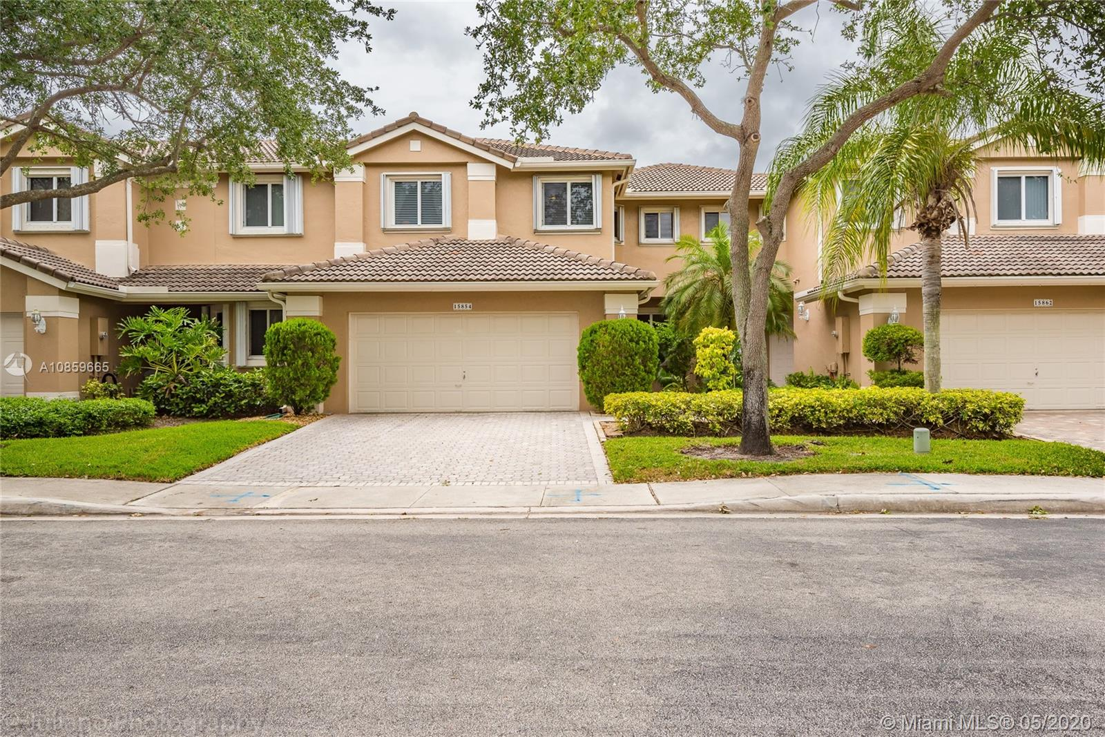 "DECORATOR'S DELIGHT!!! IMPECCABLE SPACIOUS TOWNHOME IN OPTIMAL CONDITION. LOCATED IN DESIRABLE GATED GOLF  RESORT COMMUNITY ""GRAND PALMS"" LOOKING FOR A WELL QUALIFIED BUYER THAT WILL APPRECIATE THE SERENE ATMOSPHERE OF THIS UNIT. ONE OF THE LARGEST LOTS IN COMPLEX. LARGER THAN TAX INF. PATIO OVERLOOKING A PARK-LIKE SETTING.  VOLUME CEILING AND  PLENTY OF NATURAL LIGHT. UPGRADES IN KITCHEN AND BATHROOMS. LARGE MASTER BEDROOM WITH CUSTOM WALKING CLOSET. JACUZZI ON MASTER BATH. ACCORDION HURRICANE SHUTTERS ON 2ND FLOOR AND IMPACT REAR DOOR .  ASSOCIATION PROVIDES ROOF MAINTENANCE AND  REPAIRS,TREE AND LANDSCAPING UPKEEP. COMMUNITY POOL AND INDIVIDUAL POOL FOR THE COURTYARD FAMILIES. SECURITY ENTRANCE GATE,  ADT SECURITY SYSTEM, SECURITY PATROL, BLUE STREAM TV/INTERNET , ROAD REPAIRS AND MORE!"