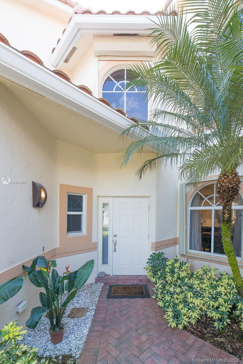 MOTIVATED OWNER! FULLY REMODELED! ABSOLUTELY GORGEOUS! Home shows like a model! Amazingly updated 3 bedroom 3 1/2 bath home perfecty situated overlooking the golf course. Brand NEW ROOF, floors,kitchen,bathrooms,fireplace, all entry doors are impact. Owner spared no expense on quality from quatrz counters to SS apliances. This home is a MUST SEE to really appreciate the detail craftmanship in the flooring. Complete house water purifing system and with multiple upgrades in garage flooring and electric. Bring your most challenging buyer.