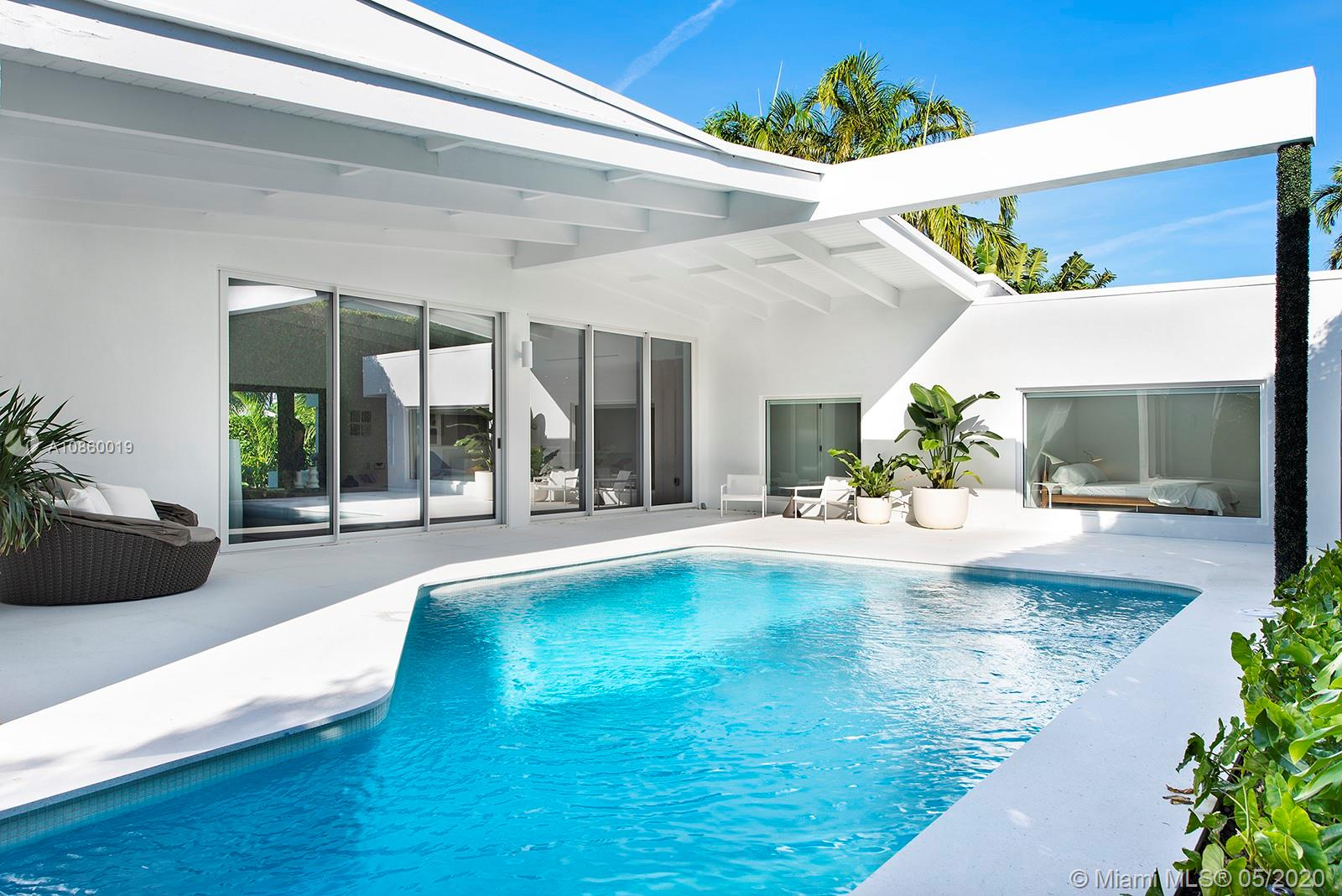 Located on the coveted Venetian Islands, this 5 bedroom 5.5 bath Mid-Century Modern home sits on an exquisite corner lot. The entry leads to an enchanting open floor plan that seamlessly connects formal & informal living spaces with 15 ft tall ceilings that is flooded with natural light and transitions to a stunning pool garden. The sleek designer chef's kitchen includes Miele & Wolf appliances and a butler's pantry; dining room has a custom temp. controlled 200+ wine cellar. The master suite has its own living area, 2-custom walk-in closets and a luxurious bathroom & spa. Features include terrazzo flooring; hurricane impact doors/windows, 2-car driveway; and more! Perfectly situated mins away from Lincoln Rd, Sunset Harbor and easy access to Brickell, Design District, & Miami Airport.