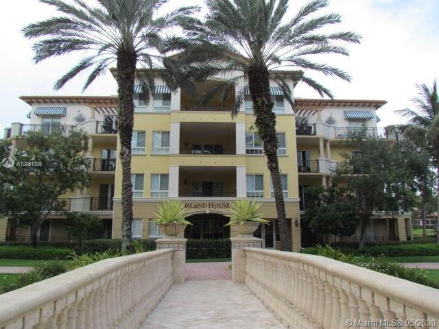 """LUXURY LIVING THE PALMS AT WESTON. BEAUTIFUL 1,725 SF CORNER UNIT LIGHT AND BRIGHT. 2 BEDROOMS / 2.5 BATHS PLUS DEN/OFFICE. LAUNDRY ROOM IN UNIT WITH TUB. LARGE KITCHEN HAS 48"""" WOOD CABINETS, GRANITE COUNTER TOPS AND STAINLESS STEEL APPLIANCES. BATHROOMS HAVE MARBLE FLOORS, WOOD CABINETS AND GRANITE COUNTER TOPS. MASTER BATH HAS A WHIRLPOOL. RELAX ON LARGE WRAP AROUND BALCONIES WITH A BEAUTIFUL WATER AND POOL VIEW. CERAMIC TILES AND CROWN MOLDING IN LIVING AREA. UNIT COMES WITH AN X-LARGE A/C STORAGE ROOM. VALET PARKING, LARGE HEATED POOL WITH TWO SPAS, FITNESS CENTER, LIBRARY, SALON, CONCIERGE, RESTAURANT(INCLUDES $60 A MONTH FOOD CREDIT). WALK TO RESTAURANTS, BANKS, SHOPPING. MINUTES TO CLEVELAND CLINIC HOSPITAL. CLOSE TO MAJOR HIGHWAYS. AN HOPA COMMUNITY."""