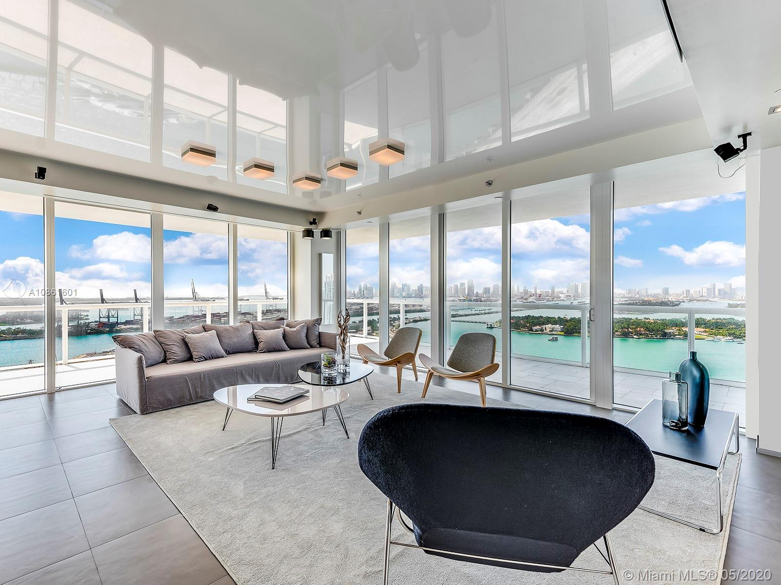 Most desirable line 01 at ICON South Beach. Professionally reconfigured to a unique 3 bedroom 3 bathrooms floor plan, designed to maximize its spectacular views of Miami Downtown, Biscayne Bay and the Atlantic Ocean. Fine finishes throughout that you must see to believe. Priceless Biscayne Bay and Ocean Views from all rooms and from the 700 SQ FT Wrap-Around Terrace.