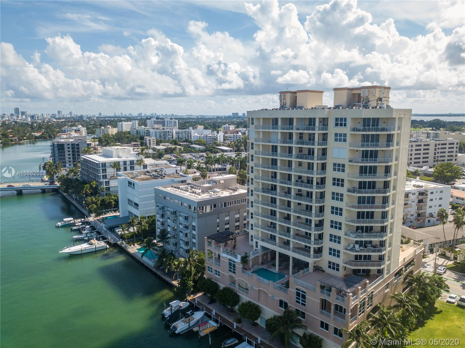 It's a beautiful 11th. floor, two-bedroom, 2.5 bathroom apartment along the intercoastal in Bay Harbor Isles with amazing ocean and city views from two ample balconies. An open floor design with wood flooring greets you as you arrive on the private elevator. It's within walking distance to Bal Harbour Shops and the building has a private boat dock available. it has a two-car garage and a storage unit. Easy to show; call or text listing agent