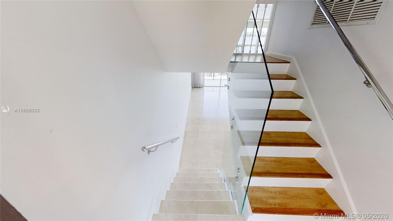 This Beautiful and Unique townhouse with amazing Biscayne Bay views and Ocean view. A 32 FT boat slip. Recently remodeled with all modern upgrades one would expect. Kitchen remodeled with white quartz counter top. Master bedroom has walk-in closet. Floor to ceiling windows. Storm shutters. Brand new A/C Unit. Direct and private access to unit. Two private covered parking spaces in front of the TownHouse. It is like living in a home but with all the luxurious condominium amenities. 24 hour security, free valet, 2 pools, spa, tennis courts, BBQ areas, Children play ground, bay walkway, gym, centrally located, walking distance to Mary Brickell Village, Brickell City Center and Financial Institutions. Centrally located to airport, malls, south beach, art center, Arena and more . A dream Home