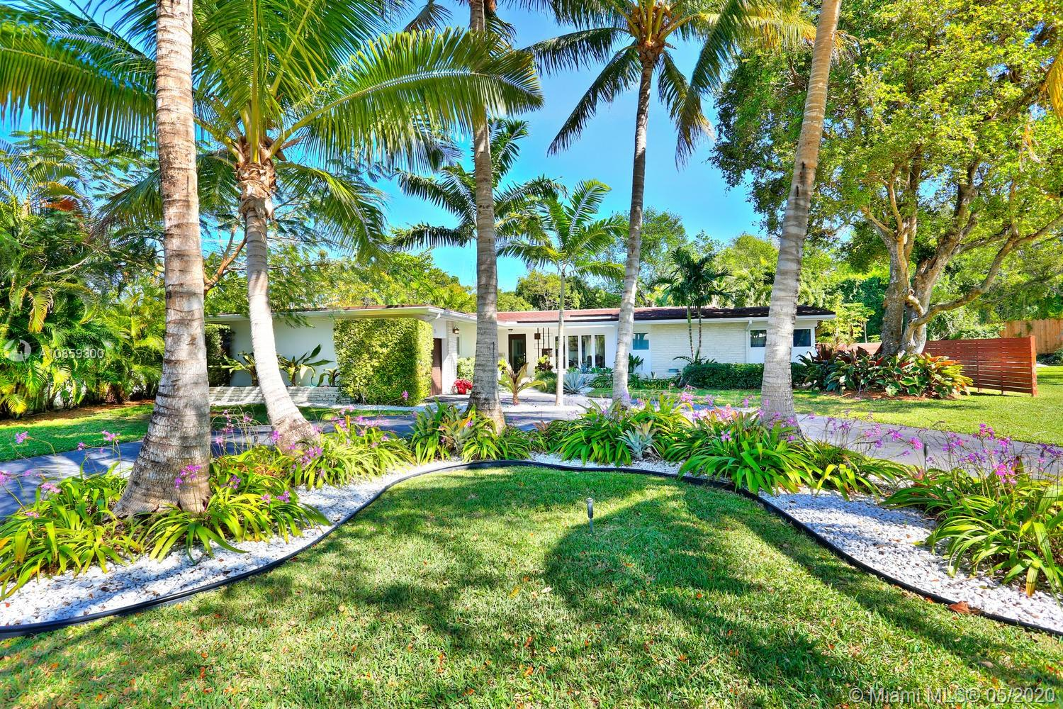 Stunning home, surrounded by close to a half-acre of lush tropical gardens in prestigious North Coconut Grove. Light-filled formal living, dining & family rooms w/walls of glass overlooking the ultra-private, resort-style pool & terrace. Major renovation in 2015, including porcelain tile & wood flooring, custom built-ins & impact glass throughout. A spectacular open kitchen features sleek euro-style wood cabinetry, stone countertops, gas range, high-end appliances, island w/seating + breakfast area. 4BR/4BA + housekeeper's room. Expansive master suite includes his & hers custom walk-in closets & spa-like bath w/soaking tub & frameless glass shower. 24/7 security patrol. 16' above sea-level. Close to the Grove village's bayfront parks & marinas and minutes to downtown, MIA & the Beaches.