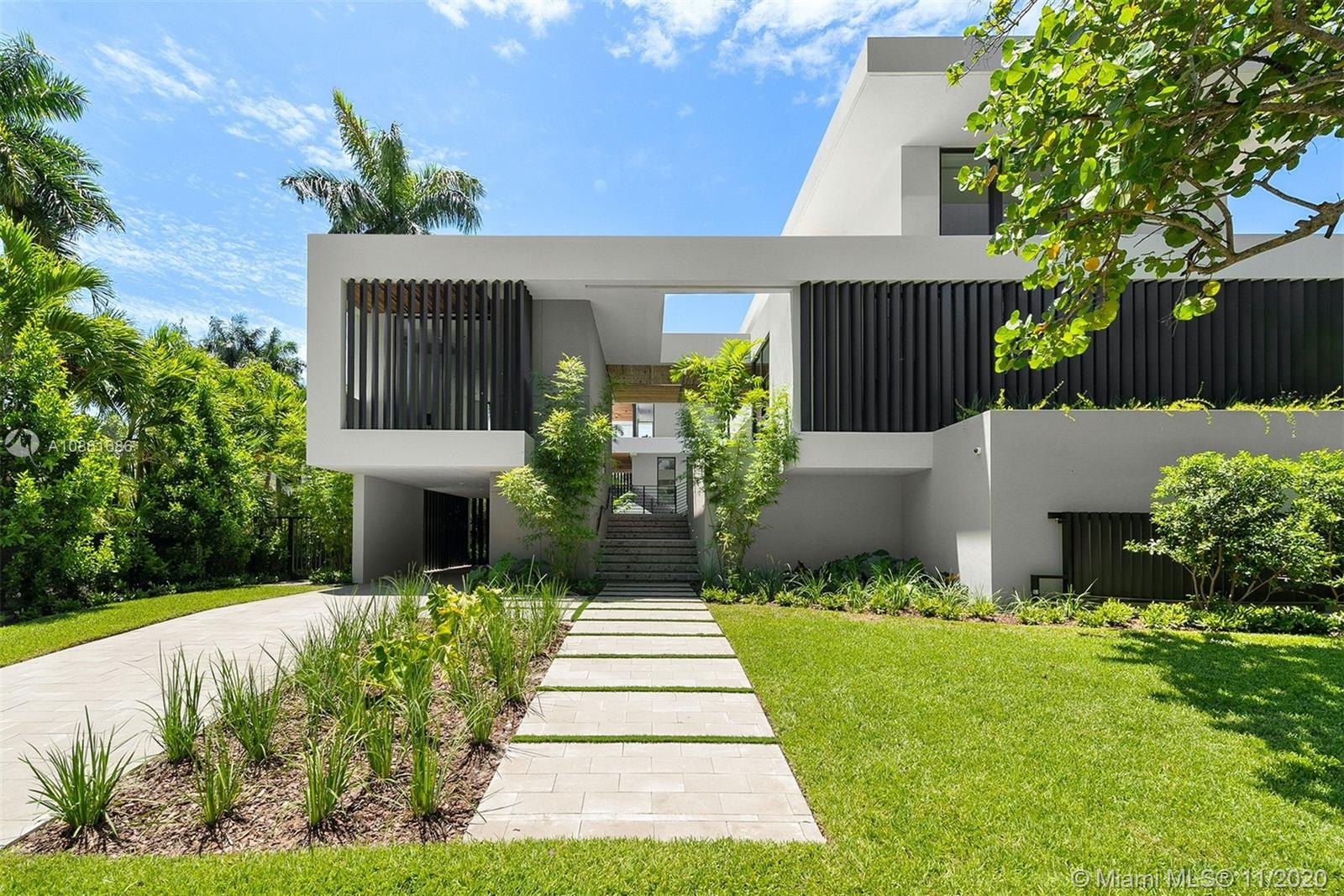 Brand new home on sought-after Entrada Estates gated community in Coconut Grove. Designed by Praxis' Jose Sanchez and built by ICH Builders, this modern Smart home is warm & elegant with clean lines and superb finishes. Boasting 7369 SF under air, the home features floor to ceiling windows that drape it in natural light, thoughtful floor plan, 250+ glass wine room, elevator, additional large room ideal as a media room/man cave/office, second family room on the top floor, 5 carports & plenty of storage. Gourmet kitchen w/ top of the line appliances, ample pantry & gorgeous countertops and Mia Cucina cabinets. Expansive grounds perfect for entertaining w/ summer kitchen & covered spaces for large gatherings. The multi-depth heated double pool allows for swimming & leisure activities.