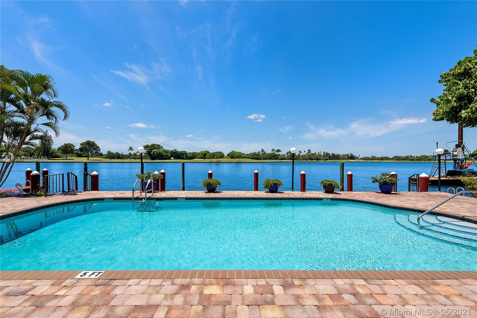 For only the second time in 6 years, a stunning bay view residence has become available in the boutique Monterey property on Bay Harbor Islands. Only 18 owners can call this spot home with wide water and Indian Creek Golf Course views. Unit 3A boasts 2,103 square feet plus a 210 sq ft private lanai where you can watch for yachts, dolphins, and manatees. Impact windows! Current floor plan 2 bedroom 2.5 baths but can be remodeled into a spacious 3 bedroom. Freshly painted building passed 40 Year Inspection including new elevator and fire system. All the elements of a home are available with the convenience of a condo: Dock avail, climate controlled storage room, salt water pool, billiards, sauna, paddleboard, kayak, bike storage! 2 parking spots Maintenance $841 or 40 cents/SqFt. No Renting