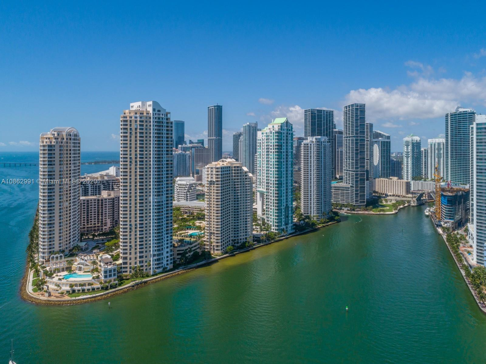The apex of luxury begins here. Welcome inside a bright and white corner unit, located on the private island of Brickell Key in Asia. Here, buyers can indulge in the Miami lifestyle, where the sun touches every angle of this 4 bed 4.5 bath renovated home. Boasting unobstructed views of Biscayne Bay, with several full-size balconies, summer can be enjoyed with ample room for entertaining. Indoors, residents can experience high design and coastal style with a large open-floor plan featuring walk-through living & dining room, and bespoke gourmet kitchen by POLIFORM.  Italian wood flooring, 12ft. ceilings, automated curtains & shades by LUTRON, lighting by Kreon, doors by RIMADESIO, walk-in closets by ORNARE & designer spa-inspired baths. 5-star amenities, staff quarters, built-in home theater