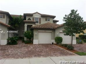 MAKE YOUR HOME IN A RESORT STYLE COMMUNITY! PRESTIGIOUS CYPRESS POINTE IN HERON BAY! Elegant 3 bedroom 2 bath coach home with 1 car garage * features split bedroom plan with laminated floors, open and bright living areas with high ceilings and tiled floors, spacious kitchen with wood cabinets and granite counters, laundry room with washer/dryer. and a screened balcony w/view of lake.* Freshly painted and newer A/C. * Gated community w/ 24/hr security. * Indulge in the spectacular Cypress Pointe & Heron Bay club houses w/ resort style amenities. featuring several large pools, Tennis courts , Basketball courts, gym, Saunas & Barbecue Areas. Jog alone the pathways with lush landscaping! * Family oriented and pet friendly. * A+ school district.  NO ASSOCIATION APPROVAL NEEDED!