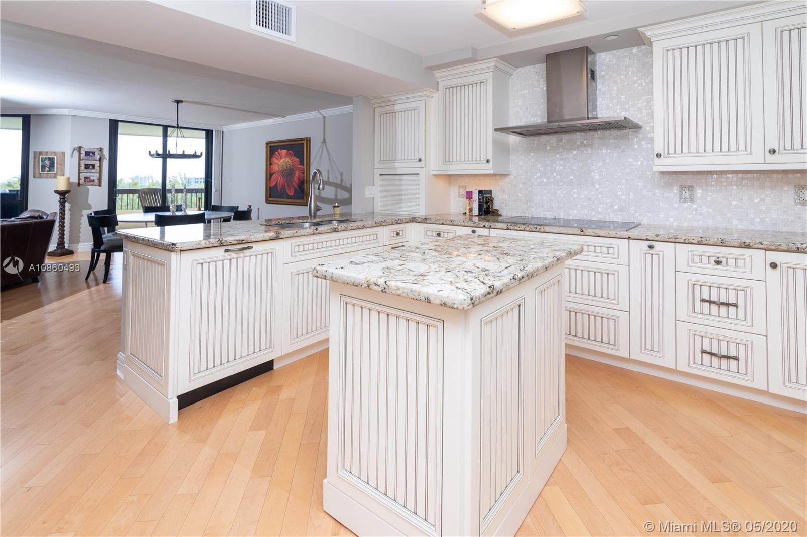 PENTHOUSE! OCEAN AND INTRACOASTAL VIEWS! THIS UNIT IS OVER APPROX 1725 SQF AND THE LARGEST MODEL WITH A 30 FT BALCONY. COMPLETELY RENOVATED WITH SPLIT FLOOR PLAN, IMPACT WINDOWS, AND VIEWS FROM EVERY ROOM! TOP QUALITY FLOORS THOUGH OUT! A/C AND WATER HEATER 2019. FEW HAVE LARGE AND ELEGANT EAT-IN OPEN KITCHEN LIKE THIS - CHEFS THIS IS FOR YOU. THE LIVING & DINING AREAS ALLOW FOR MAXIMUM LIGHT. MASTER BEDROOM HAS FURNISHED WALK IN CLOSET WITH BUILT-INS THAT COMPLIMENT A TASTEFULLY RENOVATED LARGE EN-SUITE BATHROOM. THE SECOND BEDROOM FEELS LIKE ANOTHER MASTER BEDROOM WITH A SPACIOUS BATHROOM. LAUNDRY IN UNIT. AMENITIES: PARTY ROOM, GYM, BILLIARDS, 24 HR SECURITY AND COVERED PARKING. BUILDING HAS BEEN RECENTLY RENOVATED AND KNOWN FOR ITS HIGH-END STYLE. YOU ARE MINUTES TO THE BEACH!