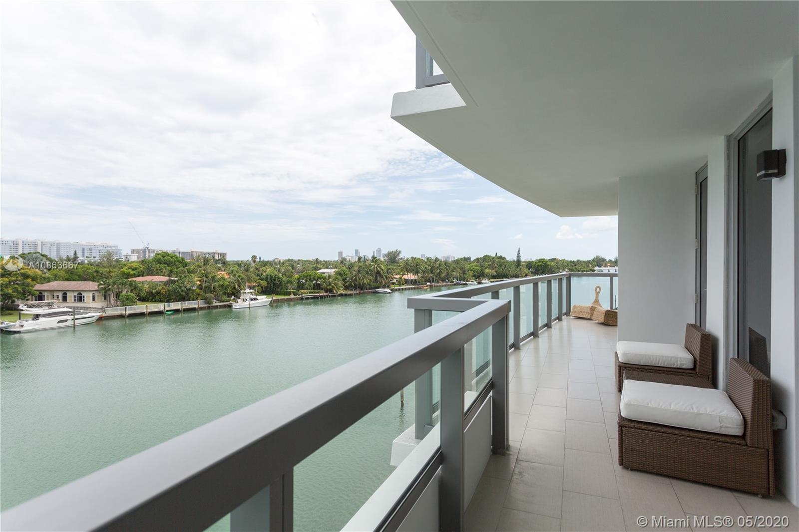 Ivory Condominium at Bay Harbor Islands Florida. almost a new Construction, 2017, Corner unit with Amazing Intercostal views. 2 bedrooms 2 baths, 1,303 Sqft, large balcony. A beautiful home or a great investment property, the city allows this building short term rentals. Kitchen, living and two bedrooms looking the Intercostal and Bal Harbour city , walking distance from Bal Harbour mall, beaches and restaurants. Gym, Pool at the terrace, 2 cover garage spaces. Close to A Schools.
