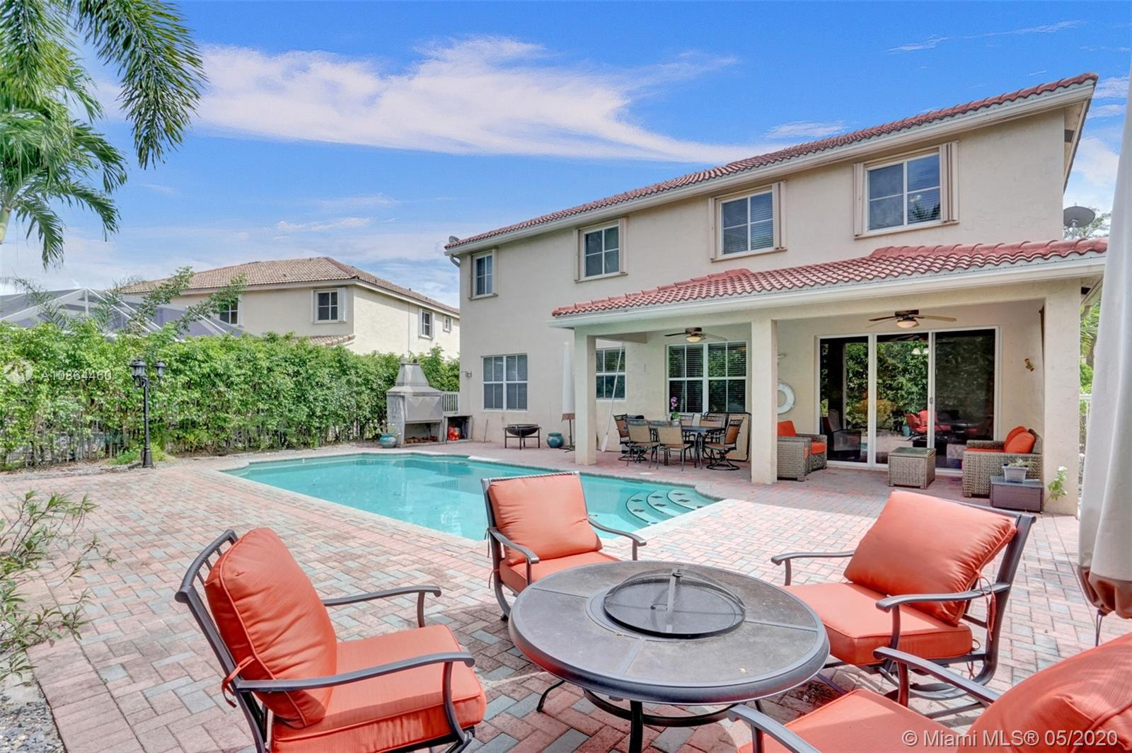 A large 6 bedroom, 4 bath pool home with lush landscaping is ready to meet your entire family. Located in the prestigious gated Weston community of The Ridges, with one of the most fabulous Community Centers. The short and easy walk to the library, middle and high schools makes me located in one of the most desirable areas of this community. My yard is landscaped for peace and privacy.  Plenty of area for entertaining outside by my paved deck pool. A complete bedroom & bath on the first level is perfect for nannies, in-laws or guests. You'll love to cook in my upgraded kitchen with granite, stainless and a perfect eat-in island. 3 car garage will store all the cars, bikes, and more. You will have an easy commute to 75 & 595 & the tranquil large lakes welcome you home to stress free living.