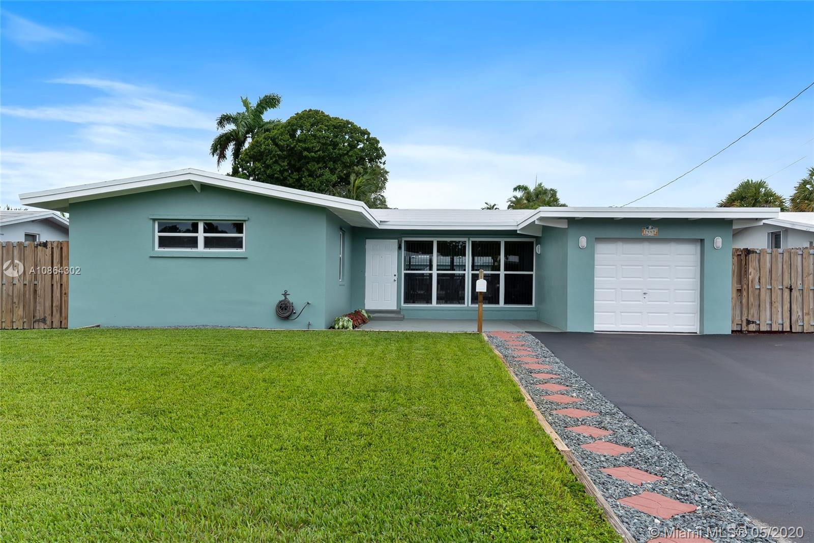 Spacious waterfront home with ocean access in Lauderdale Isles (Riverland) features 3 bedrooms, 2 bathrooms, 1-car garage, new roof (2019), 2 A/C units (2020 and 2013), built-up seawall w/ footers & tiebacks, updated wood dock w/ 3 pilings, 10,000lb boat lift w/ access to electric & plumbing, laundry room w/ storage, soaring vaulted wood ceilings, tile flooring throughout, newly painted interior and exterior, lots of natural lighting, updated windows and hurricane shutters, updated electrical, 65ft waterfront footage, 60ft canal width, and the only fixed bridge is I-95 (just over 50ft).  Prime location on a dead-end street, minutes from highway, downtown and the beaches, and less than a mile away from public boat ramp.  Check out the Virtual Tour (Matterport) for an exclusive online tour.