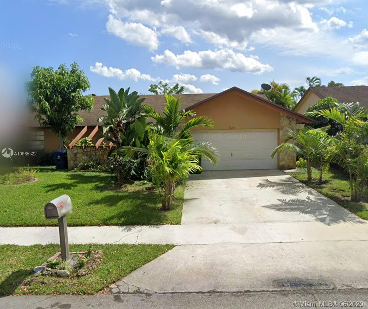 Beautiful one-story home in northwest Lauderhill. Very open, high vaulted ceilings, private yard, fruit trees. This home will not last!