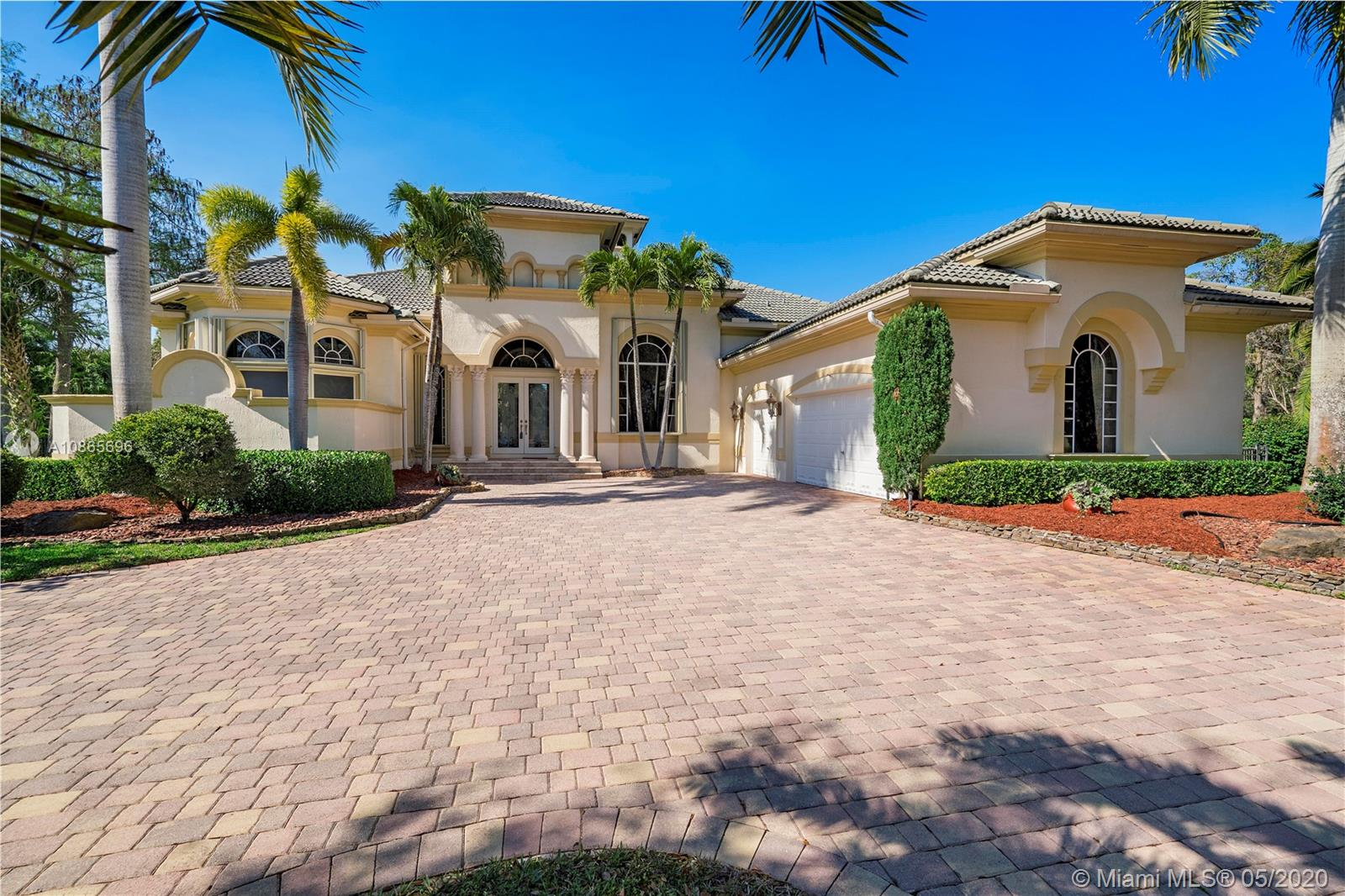 Pride of Ownership is evident as soon as you walk into this exquisite custom built home in Grand Cypress Estates. This ½ acre pool home has every upgrade a customer builder could provide. If you like elegant wood, then the floors, woodwork, built ins and molding will hold your attention. The unique ceilings, architectural archways and walls will be a point of conversation. One look at the fully equipped Sub-Zero Bosch appointed kitchen and the cook won't want to leave one granite counter top untouched. Warm up on a cool night in front of your fireplace or enjoy the Florida lifestyle from your crystal clear pool. The floor plan, bed and bath design opens up lots of possibilities. You have price, comfort, elegance, style and luxury calling your name. Don't miss your call.