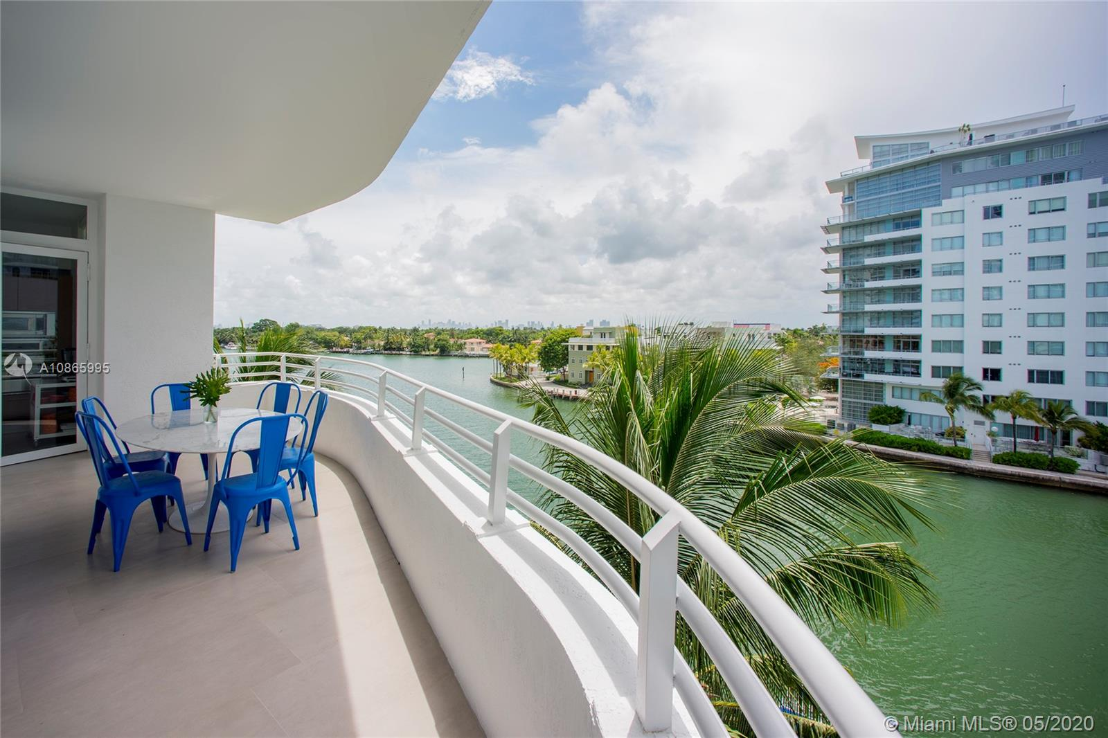 Laid-back luxury in prime waterfront location! Enjoy relaxed living and panoramic views in a large, peaceful, 3 bed / 3 bath furnished condo at Nautica, a boutique full-service building w/ doorman, 24 hr security, rooftop pool, spa, gym, and marina. Turnkey unit boasts the best floor plan in the building, with two balconies, each overlooking beautiful Indian Creek, home to some of Miami Beach's most iconic residences. The generous wraparound terrace provides the perfect setting for entertaining or dining alfresco. Fully renovated —new floors, kitchen, bathrooms — with washer & dryer and floor-to-ceiling impact windows throughout. Includes two parking spaces. Across the street from the beach. Minutes from supermarkets, restaurants, shopping, golf courses, rowing club, and Mt Sinai Hospital.