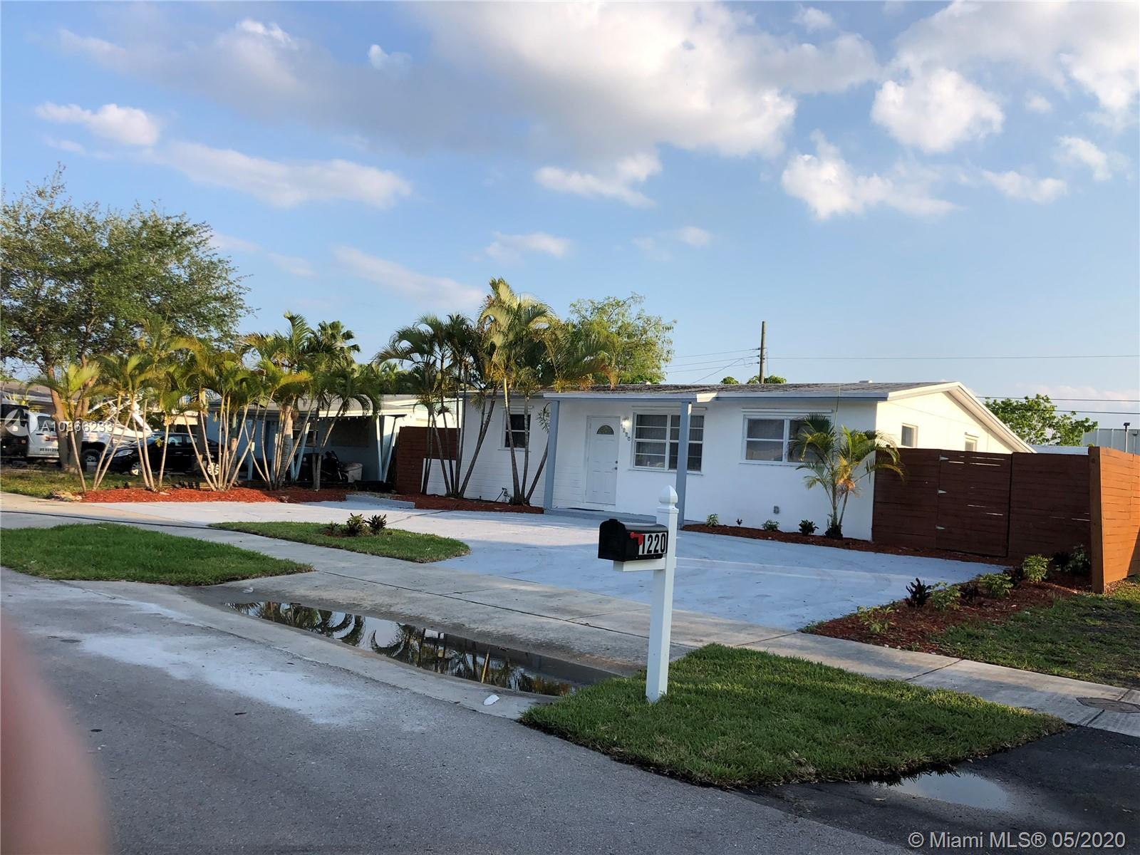Beautiful 3/2 Remodel home with and additional guests house,  with Pool and Canal View, new roof.