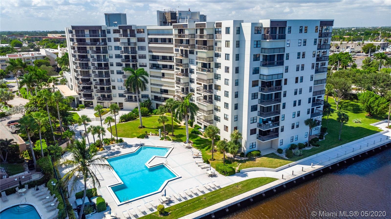 INTRACOASTAL VIEW AND TREES, TREES, TREES! THIS UNIT IS THE LARGEST MODEL WITH A 30 FT BALCONY. COMPLETELY RENOVATED WITH SPLIT FLOOR PLAN, IMPACT WINDOWS, AND VIEWS FROM EVERY ROOM! TOP QUALITY FLOORS THOUGH OUT! A/C AND WATER HEATER UNDER 5 YR. FEW HAVE LARGE AND ELEGANT EAT-IN OPEN KITCHEN LIKE THIS - CHEFS THIS IS FOR YOU. THE LIVING & DINING AREAS ALLOW FOR MAXIMUM LIGHT. MASTER BEDROOM HAS FURNISHED WALK IN CLOSET WITH BUILT-INS THAT COMPLIMENT A TASTEFULLY RENOVATED EN-SUITE BATHROOM. THE SECOND BEDROOM FEELS LIKE ANOTHER MASTER BEDROOM WITH A SPACIOUS BATHROOM. LAUNDRY IN UNIT. AMENITIES: PARTY ROOM, GYM, BILLIARDS, 24 HR SECURITY AND COVERED PARKING. BUILDING HAS BEEN RECENTLY RENOVATED AND KNOWN FOR ITS HIGH-END STYLE. YOU ARE MINUTES TO THE BEACH!