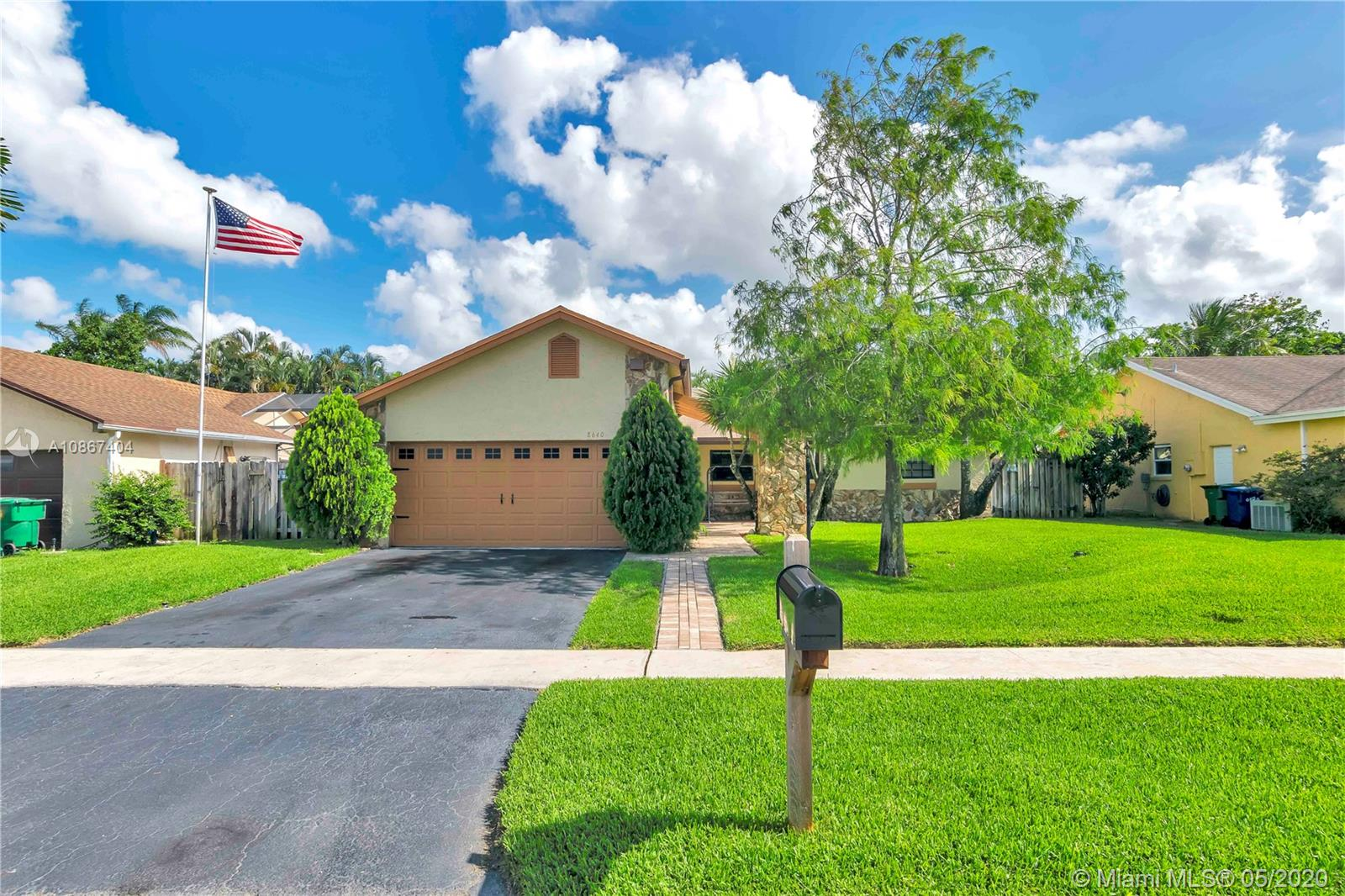 Gorgeous well maintained 3/2 with pool in Lauderhill! Pride in ownership shows in this home. Wood laminate floors & carpet in bedrooms (2018). Stone fireplace in the living room. Kitchen has wood cabinets, large island, and new glass stove top. Roof 2019, A/C 2012, Pool refinished with new motor, filter system, chlorinator and light (2020) Beautifully landscaped back yard is perfect for entertaining with gazebo and plenty of room to BBQ, and pavers surrounding pool area. Some other upgrades inc. interior paint (2018), tankless water heater, solar security lights, gutters, too many to list! Part of the garage has been converted to an extra room and office (can be converted back). Perfect for bigger families, in law quarter, and working from home. NO HOA! Within walking distance to schools!