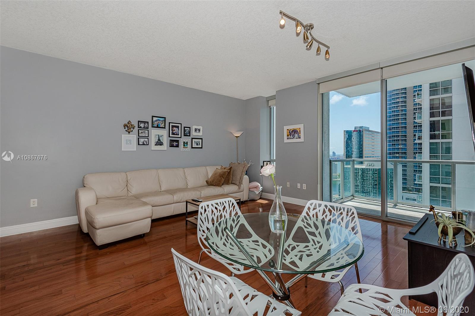 Welcome to the best value for a large 1 bed corner unit with large wrap around terrace with partial bay and fantastic skyline and sunset views located at 1050 Brickell. Features include: Pergo wood flooring throughout, Bosch & kitchen aid stainless steal appliances in your huge chef kitchen with tons of cabinet space, upgraded full washer/dryer, floor to ceiling windows in the living room with fantastic skyline views. The master suite is generously distributed with natural light as well as upgraded blackout blinds. Have access to your huge walk in closet for tons of storage. Your master bath retreat includes a tub/shower as well as marble flooring throughout the bathroom.  Walk directly out of 1050 Brickell into Mary Brickell Village to shops & restaurants. Steps from Brickell City Centre.