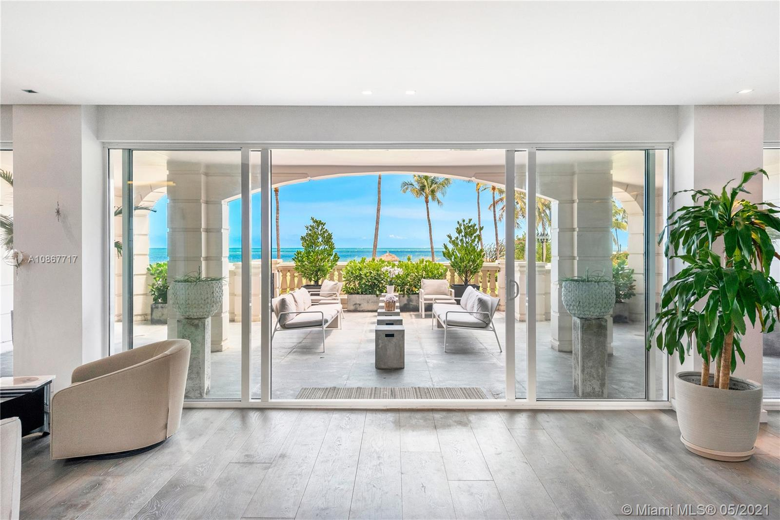 This stunning ground-floor Oceanside unit on Fisher Island redefines luxury living at its finest. Completely renovated to perfection this masterpiece encompasses 5,800 sq. ft. interior, 4 bedrooms, 4.5 baths, and showcases expansive terraces steps away from the sandy beach. Professionally designed, the unit features an open layout with a formal dining, living, exquisite wood and marble floors, a state-of-the-art kitchen, and bathrooms, impact glass doors, wine cellar, a spacious master bedroom with his and her walk-in closet, and many more features. Live the Fisher Island lifestyle in this private oasis!