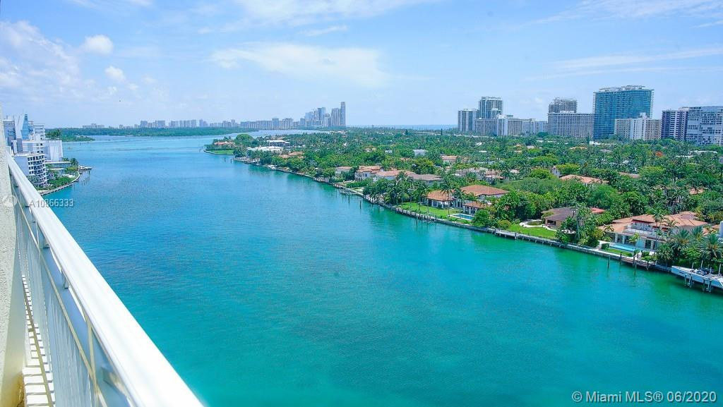 HUGE, Beautiful 3 bedroom/3.5 bath in lovely Bay Harbor Islands.  2 Condos put together- 3341SF.  Spectacular views of the intracoastal and ocean.  4 wraparound balconies.  Spacious upgraded kitchen with 2 sinks & washer/dryer.  Many upgrades.  Huge master suite with his/her closets.  Office with wood built-ins.  Wine cooler & built-in entertainment center in living room.   includes 4 covered Parking spaces.  Very few Condos this SIZE!  Sold As-Is with right to inspect.  Walk to Bal Harbour Shops, beach, restaurants.  All amenities. YOUR BUYER WILL LOVE! Call to see today.