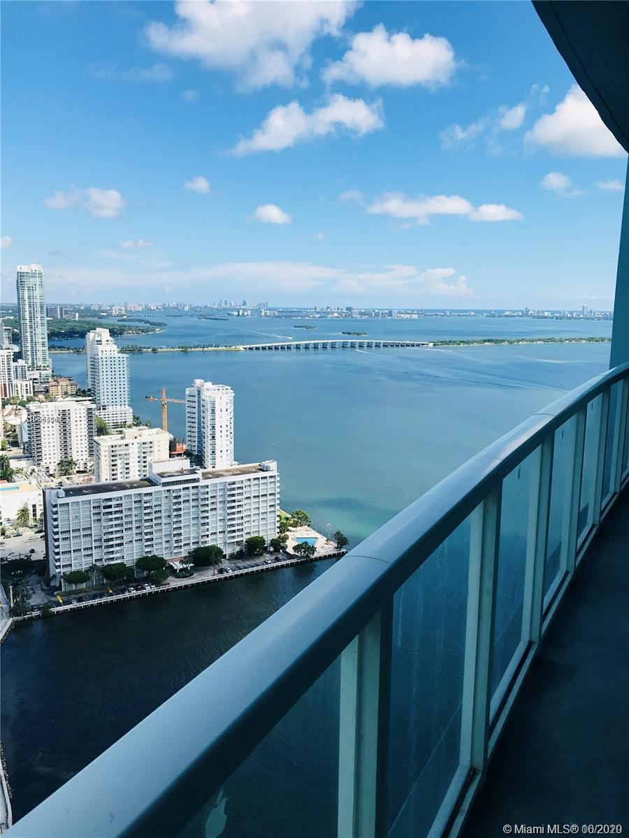 Motivated Sellers! Come see this beautiful unit with spectacular bay and city views. 1 bed + 1 bath condo on the 42nd floor of the luxurious Quantum on the Bay building. Unit offers wood floors, stainless steel appliances, updated bathroom, walk-in closet, balcony overlooks one of the pools along with the amazing views. 1 assigned parking space. Amenities include an Exquisite lobby, Concierge service, event room, 2 pools, sauna, landscaped pool deck overlooking the bay, club room with billiard table, Theatre, buisness center, fitness center, high security monitoring system, working Art studio. Excellent location in front of the Margaret Bay park. Walking distance to shopping & dinning. Close to Brickell, Downtown, Wynwood, Midtown, Design District. Don't miss the AMAZING opportunity!