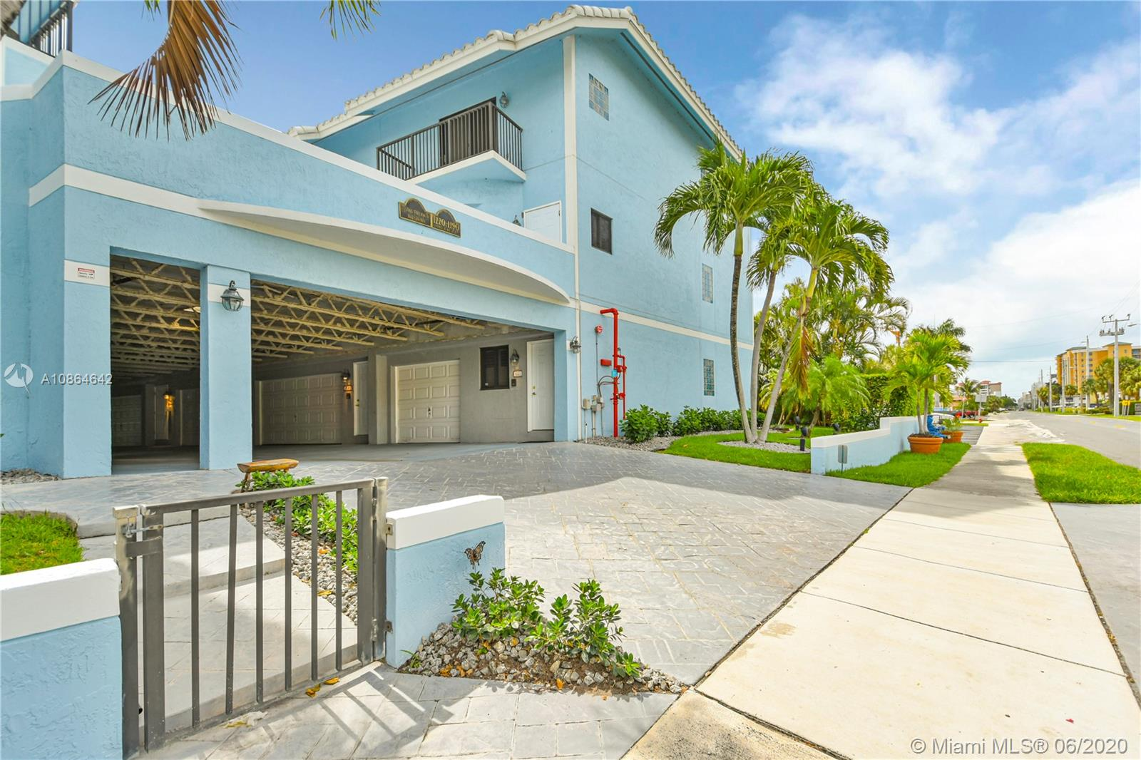 Fabulous tri-level town home with beach and intracoastal views from nearly every window. Large corner unit with great light and enormous open concept living. 3Br/2.5 Baths w/3rd floor private master suite including balcony. All bedrooms have walk in closets. Interior elevator, attached one car over sized garage w/bonus ground floor en-suite perfect for in-laws, rentals or extra living. Sliding glass doors open to a private fenced yard/patio. Additional central courtyard/patio off of main living room/great room. Literally steps from the beach and everything booming Pompano Beach has to offer!