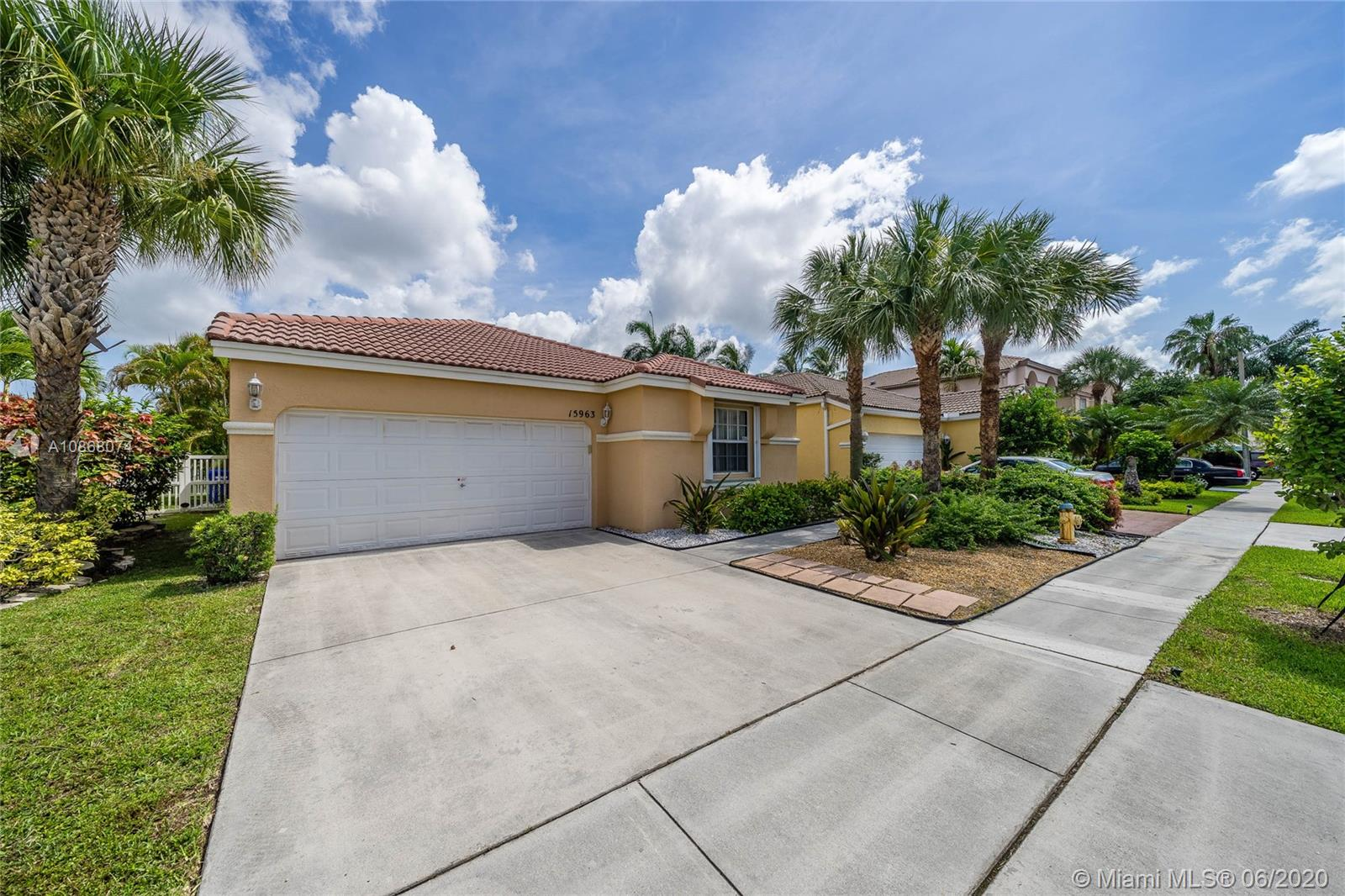 Exquisite lake front one story home in a gated community! Lushly land escaped front w/plenty of guest parking across the street. Meticulously maintained, offering a split floor plan, w/real Bamboo wood floors,crown moldings & recess lights. Open kitchen w/wood cabinets granite counters & stainless steel appliances, adjacent from the family room & breakfast area. Separate formal living & dining areas. Master suite offers his & her closet w/organizers dual sink separate shower & the view of the lake. Full size laundry room w/cabinets,Bedroom 2 & 3 offer great closet space w/built in organizers. Winner back yard offering a huge screened in patio over looking the majestic lake. walk through video: please copy & past link https://my.matterport.com/show/?m=cEPoU1YvRqb&brand=0