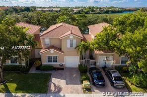 This is the one! Beautiful 3 Bed 2.5 bath townhouse in the gated community Waterways in Pembroke Pines. This adorable home on water features an open plan with gorgeous wood floors upstairs, tiled throughout downstairs, screened patio, and fully fenced yard. Kitchen includes newer appliances, new A/C & Hot-water heater. 'A' rated schools - all grades within walking distance. Pembroke Gardens & Pembroke Lakes Mall, Memorial West hospital, I-75, FL Turnpike all close by. This home is very spacious and airy. It feels like a single family home. A must see!