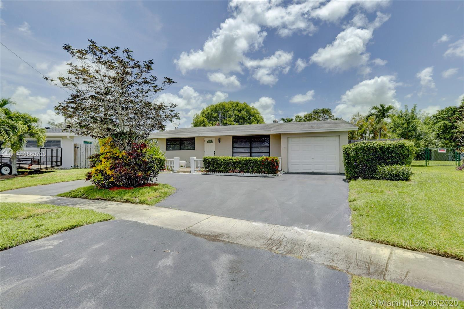 Stunning 2 bedrooms 2 bathroom home, completely remodeled in Sunrise Golf Village! Well positioned on oversized 9800+ sq ft lot! Gorgeous kitchen features white wood cabinetry/pantry with pull out drawers, granite countertops/tile backsplash, stainless steel appliances & gas range. Real dark wood flooring throughout main living areas & bedrooms. Open layout with tons of natural light. Great for entertaining. Recessed lighting. 1 car garage. Huge lot with great privacy. Circular driveway. Updated General Electric Panel. AC 2012. Water Heater 2015. Roof 2006. No HOA. This home is a must see!