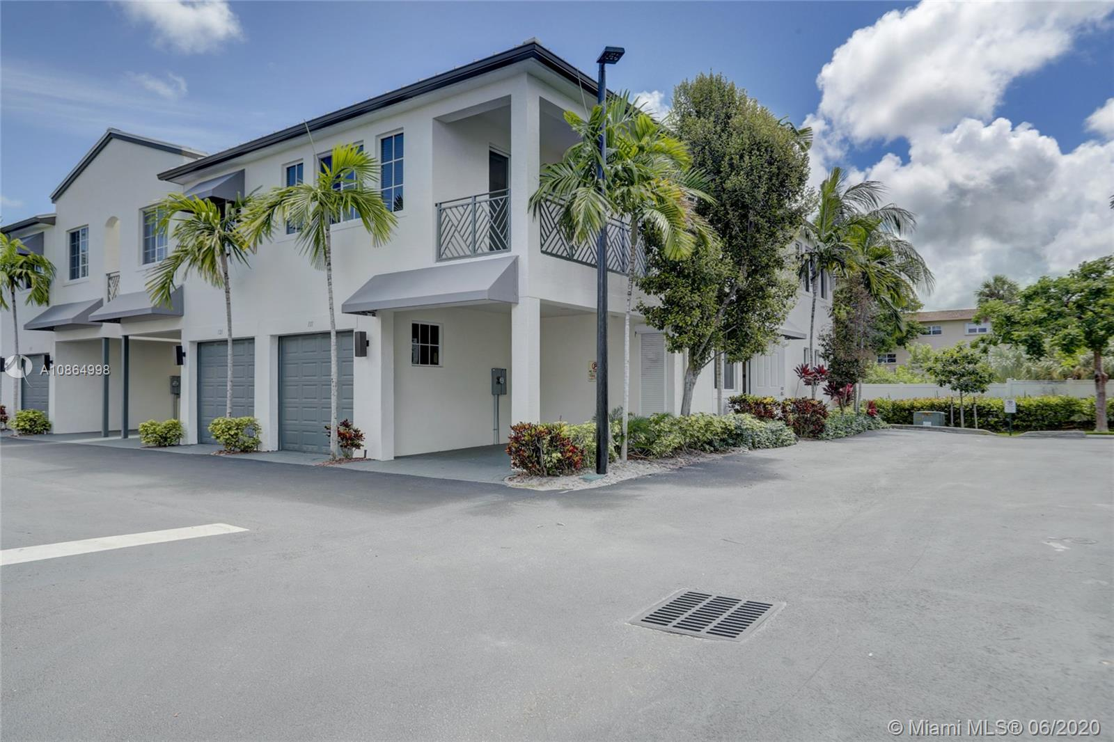 Wow, move-in ready 3/3.5 townhouse priced 70k below newer models in the community with similar finishes & low HOA fees.  This two-story, northwest facing end unit includes a huge loft in a gated community in up & coming Pompano Beach. Recent upgrades include kitchen cabinet crown molding, new awnings & light fixtures & freshly painted inside & out. Open & inviting floor plan with 3 over-sized bedrooms including a downstairs master with Jacuzzi tub, & two second level en-suite bedrooms that could also be a master. Open kitchen overlooking the spacious family room & breakfast nook. Tile flooring on the first floor & carpet on the second. Huge loft upstairs can be used as an entertainment room, gym, or play area for the kids. Impact windows & doors, plus one car garage and carport.